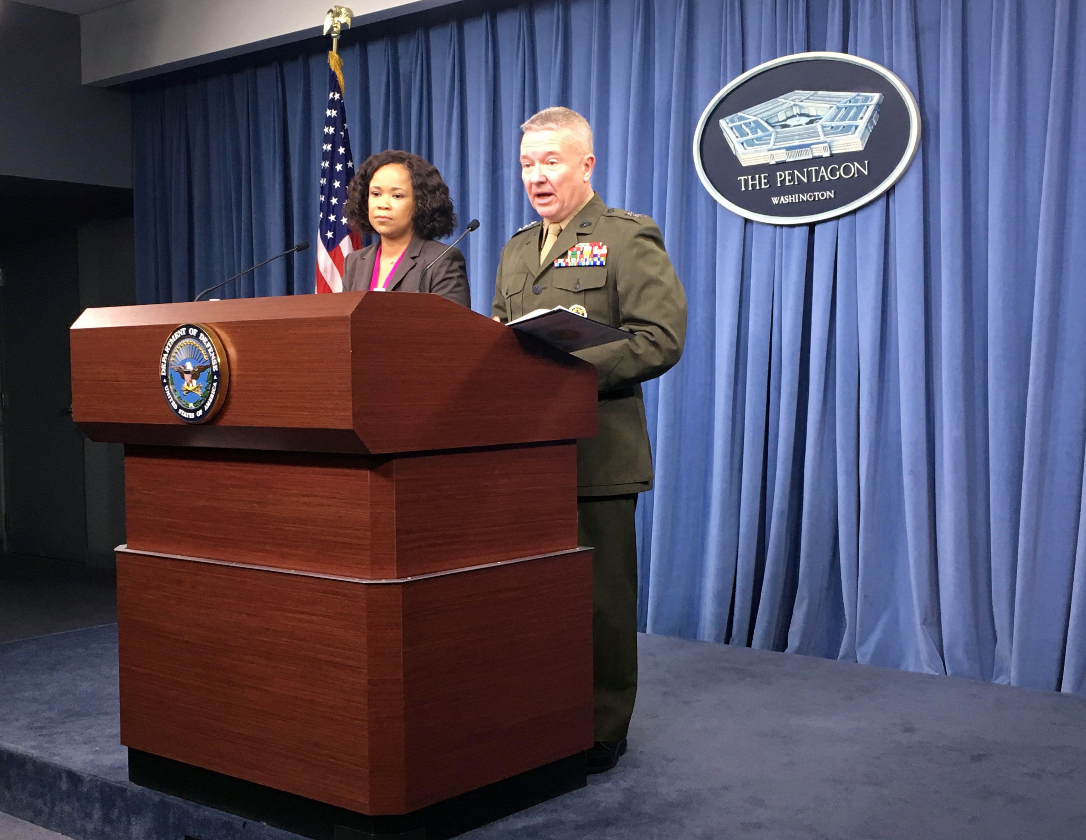 Pentagon spokeswoman Dana White and Marine Lieutenant General Kenneth McKenzie Jr. brief the media at the Pentagon in this April 5, 2018 photo in Washington, DC. (THOMAS WATKINS/AFP/Getty Images)