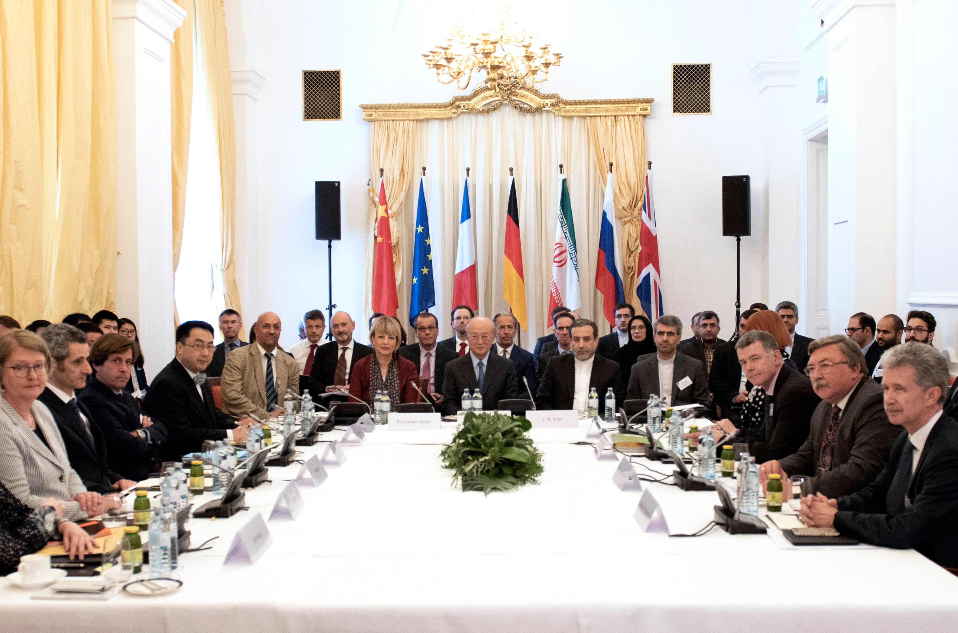 (CL to CR) Secretary General of the European Union External Action Service (EEAS) Helga Schmid, Director General of the International Atomic Energy Agency IAEA, Yukiya Amano and political deputy at the Ministry of Foreign Affairs of Iran Abbas Araghchi attend a special meeting of the Joint Commission of parties to the JCPOA (Joint Comprehensive Plan of Action) on Iran's nuclear deal at Coburg palace in Vienna, Austria on May 25, 2018. (Photo credit should read JOE KLAMAR/AFP/Getty Images)