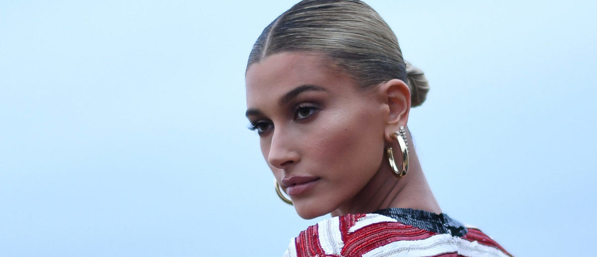 US model Hailey Baldwin arrives for the Saint Laurent Men's Spring-Summer 2020 runway show in Malibu, California, on June 6, 2019. (Photo by Valerie MACON / AFP) (Photo credit VALERIE MACON/AFP/Getty Images)