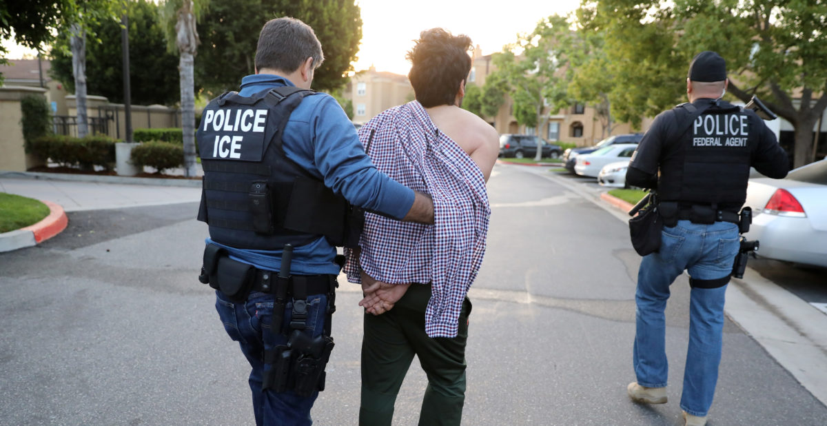 U.S. Immigration and Customs Enforcement (ICE) Assistant Field Office Director Jorge Field (L), 53, arrests an Iranian immigrant in San Clemente, California, U.S., May 11, 2017. REUTERS/Lucy Nicholson