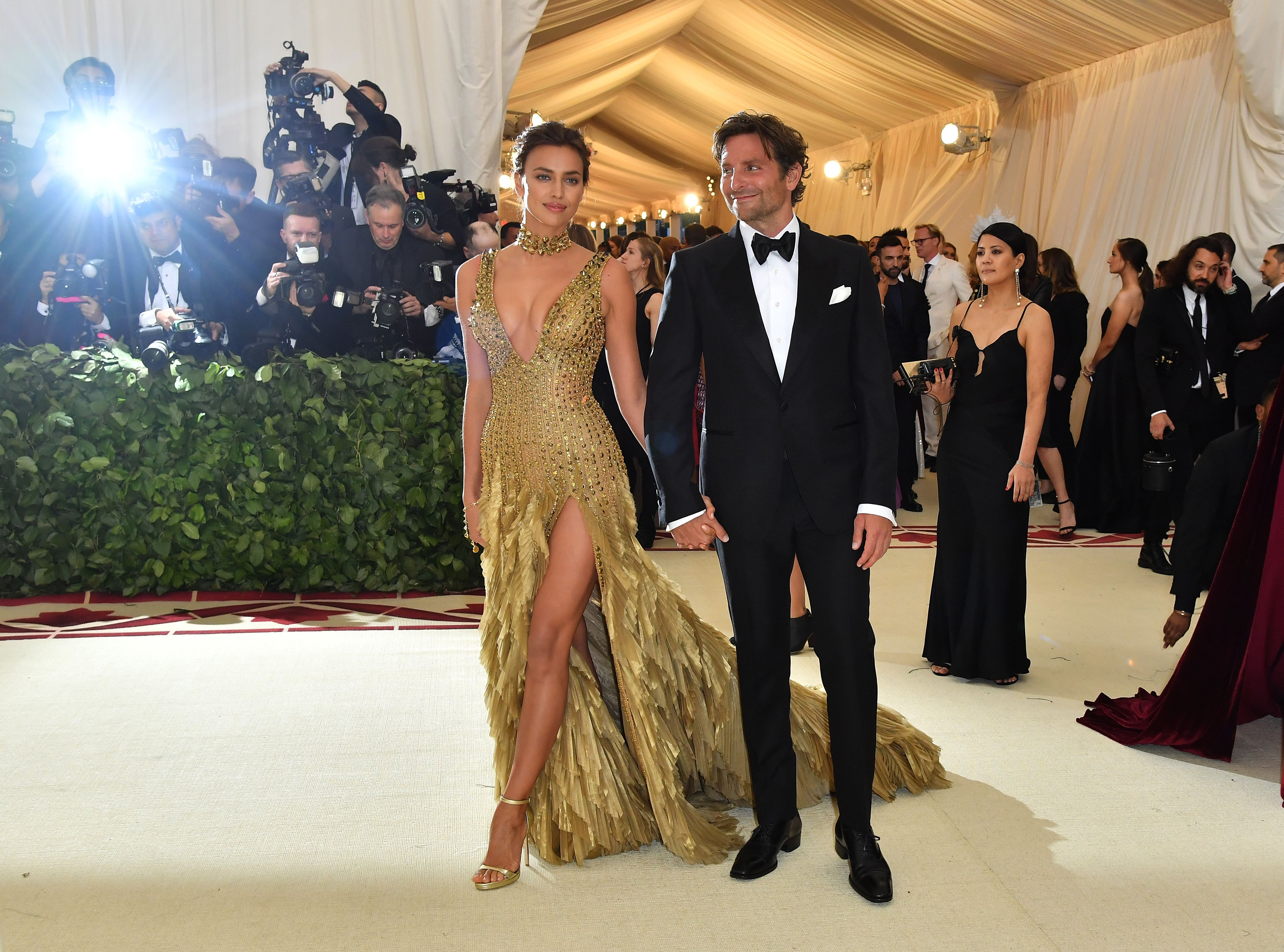 Irina Shayk and Bradley Cooper arrive for the 2018 Met Gala on May 7, 2018, at the Metropolitan Museum of Art in New York. - The Gala raises money for the Metropolitan Museum of Arts Costume Institute. The Gala's 2018 theme is Heavenly Bodies: Fashion and the Catholic Imagination. (Photo credit ANGELA WEISS/AFP/Getty Images)
