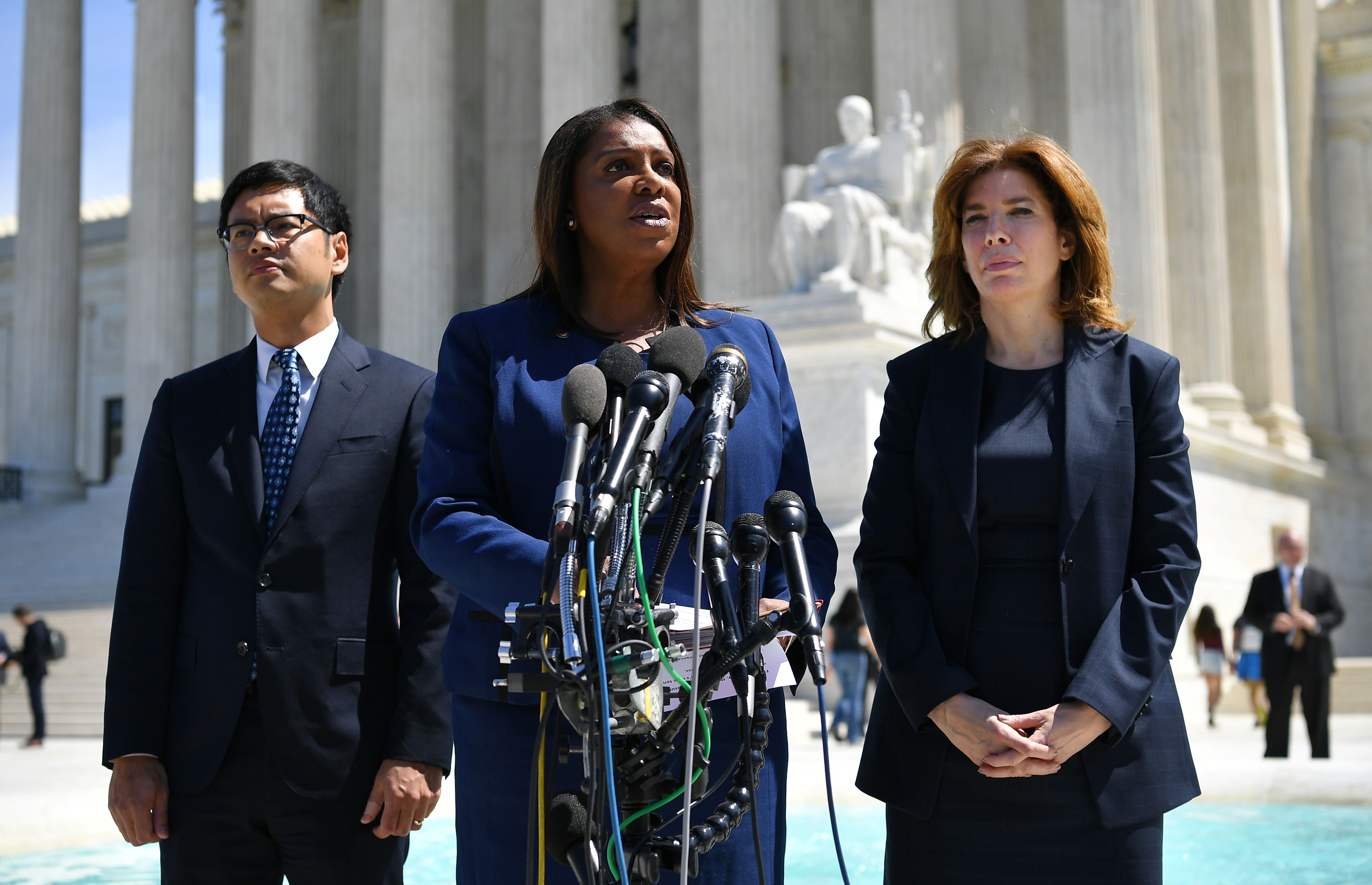 The plaintiffs in the census citizenship question case -- New York Attorney General Letitia James (C) New York City Census Director Julie Menin (R) and the ACLU's Dale Ho (L) -- speak to reporters outside of the Supreme Court on April 23, 2019 (Mandel Ngan/AFP/Getty Images)