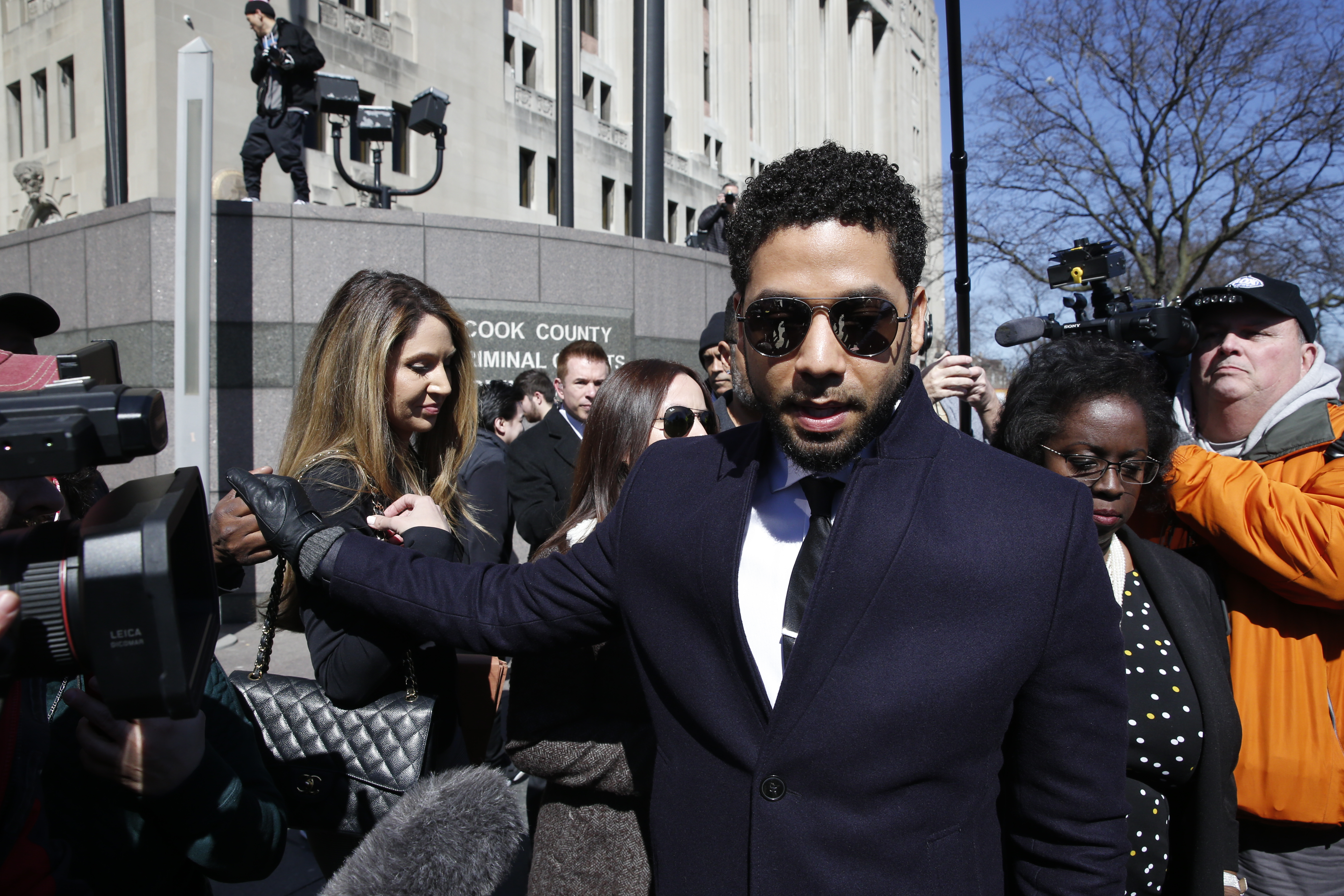 Jussie Smollett leaves with attorney Patricia Brown Holmes, right, following his court appearance at Leighton Courthouse on March 26, 2019 in Chicago, Illinois. This morning in court it was announced that all charges were dropped against the actor. (Photo by Nuccio DiNuzzo/Getty Images)