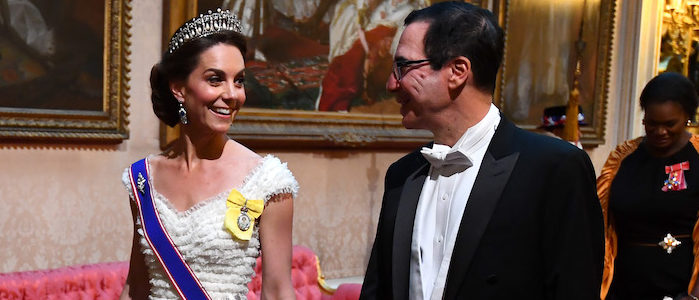 The Duchess of Cambridge and United States Secretary of the Treasury, Steven Mnuchin arrive through the East Gallery during the State Banquet at Buckingham Palace, London, on day one of the US President's three day state visit to the UK. PRESS ASSOCIATION Photo. Picture date: Monday June 3, 2019. See PA story ROYAL Trump. Photo credit: Victoria Jones/PA Wire