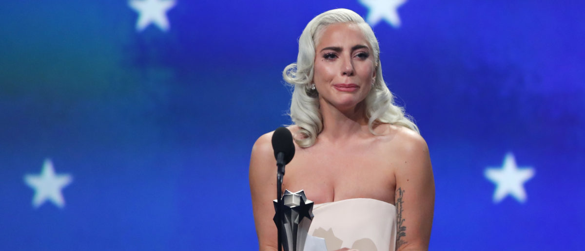 """24th Critics Choice Awards - Show - Santa Monica, California, U.S., January 13, 2019 - Lady Gaga reacts as she accepts the award for Best Actress for """"A Star is Born"""" in a tie with Glenn Close (not pictured) who won for """"The Wife."""" REUTERS/Mike Blake"""
