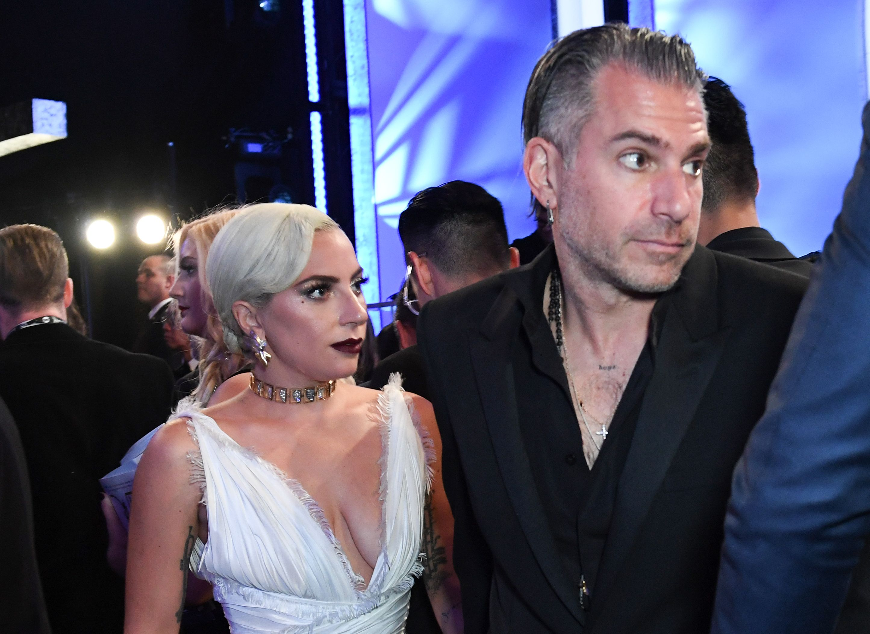 Actress Lady Gaga (L) and fiance Christian Carino attend the 25th Annual Screen Actors Guild Awards show at the Shrine Auditorium in Los Angeles on January 27, 2019. (Photo by VALERIE MACON / AFP) (Photo credit should read VALERIE MACON/AFP/Getty Images)
