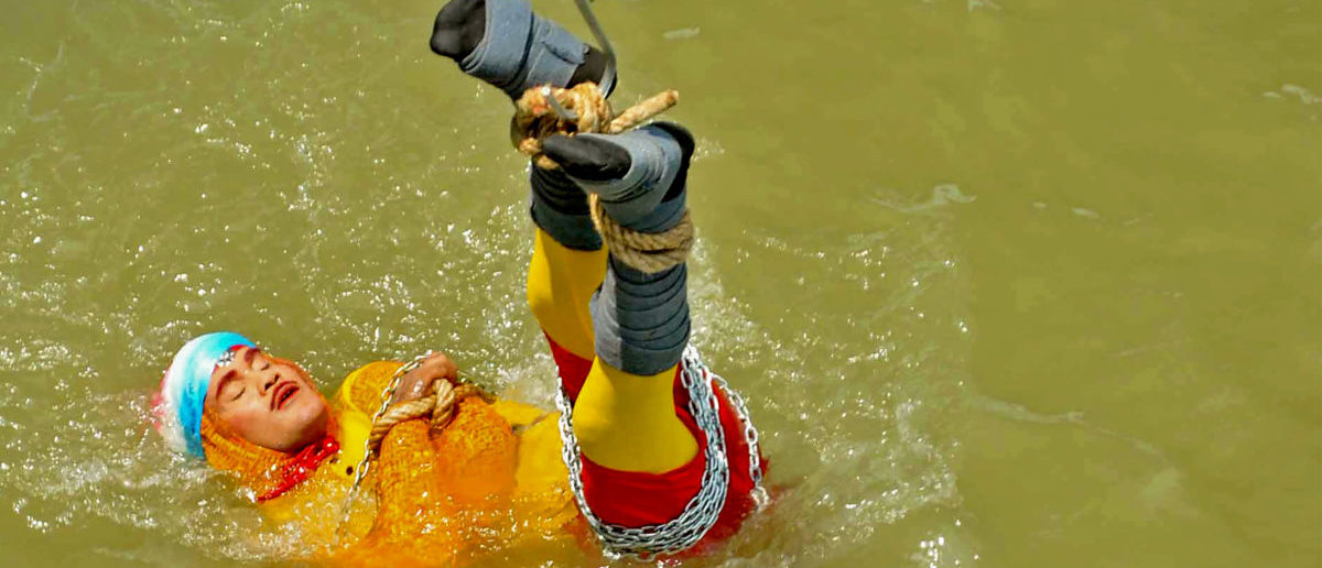 An Indian magician who went missing after being lowered into a river tied up in chains and ropes in a Houdini-inspired stunt is feared drowned, police said June 17. STR/AFP/Getty Images