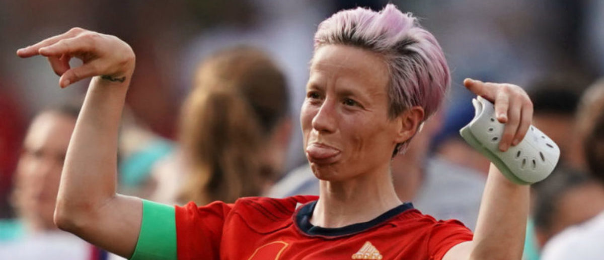 United States' forward Megan Rapinoe celebrates at the end of the France 2019 Women's World Cup round of sixteen football match between Spain and USA, on June 24, 2019, at the Auguste-Delaune stadium in Reims, northern France. (Photo credit: LIONEL BONAVENTURE/AFP/Getty Images)