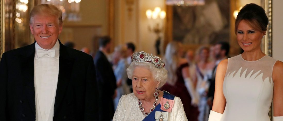 Britain's Queen Elizabeth II (C), US President Donald Trump (L), and US First Lady Melania Trump pose for a photograph in the Music Room, ahead of a State Banquet in the ballroom, at Buckingham Palace in central London on June 3, 2019, on the first day of the US president and First Lady's three-day State Visit to the UK. (Photo credit: ALASTAIR GRANT/AFP/Getty Images)