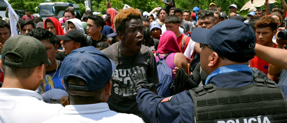 FILE PHOTO: A migrant argues with a federal police officer during a joint operation by the Mexican government to stop a caravan of Central American migrants on their way to the U.S., at Metapa de Dominguez, in Chiapas state, Mexico June 5, 2019. REUTERS/Jose Torres