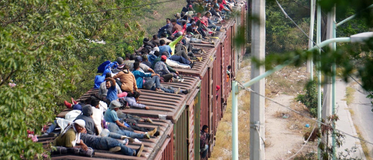 "FILE PHOTO: Central American migrants, moving in a caravan through Juchitan, Oaxaca are pictured atop a train known as ""The Beast"" while continuing their journey toward the United States, in Mexico April 26, 2019. REUTERS/Jose de Jesus Cortes"
