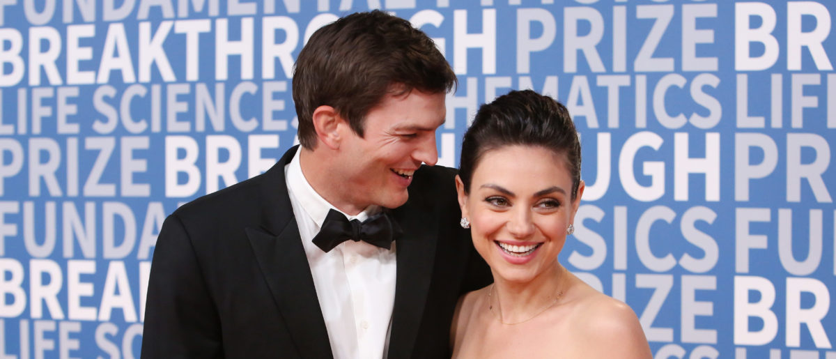 Actors Ashton Kutcher (L) and Mila Kunis attend the 2018 Breakthrough Prize at NASA Ames Research Center on December 3, 2017 in Mountain View, California. (Photo by Jesse Grant/Getty Images)