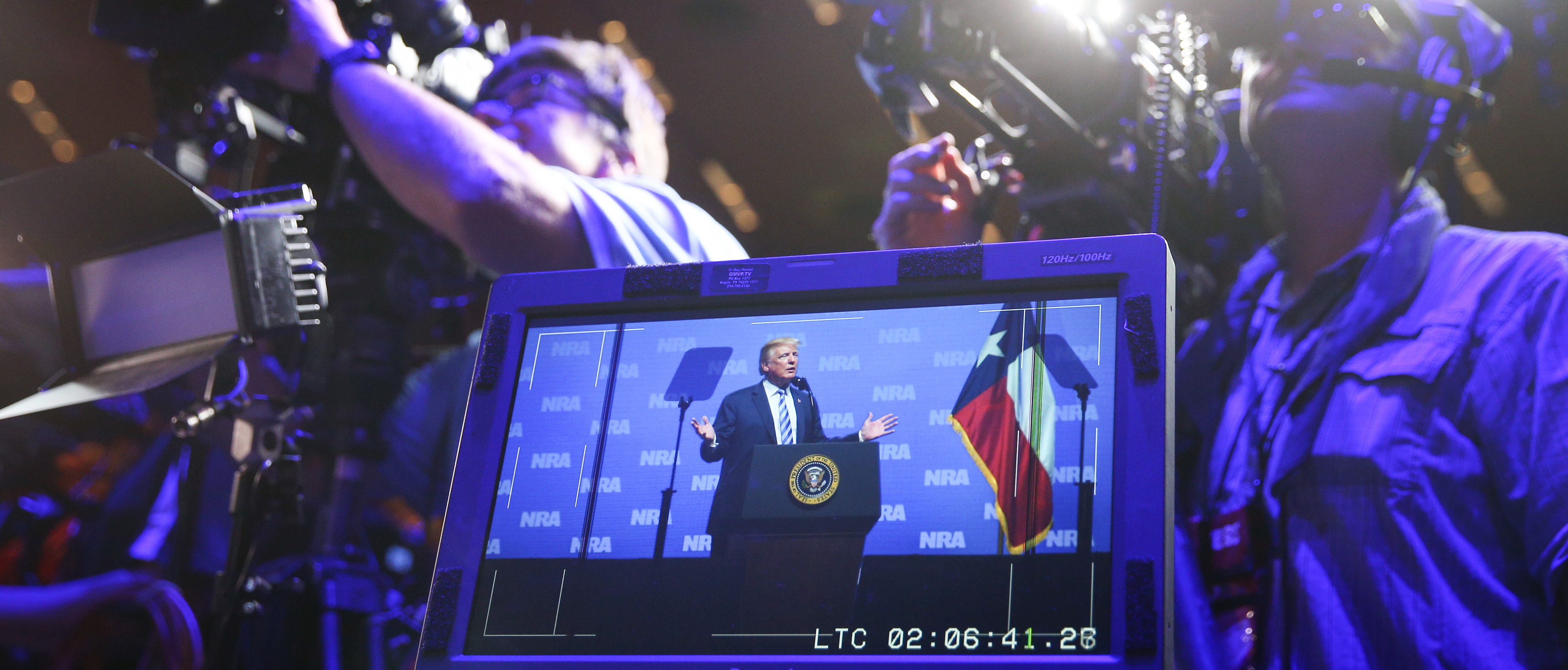 Television crews film as US President Donald Trump speaks at the NRA-ILA Leadership Forum during the NRA Annual Meeting & Exhibits at the Kay Bailey Hutchison Convention Center on May 4, 2018 in Dallas, Texas. (Photo by LOREN ELLIOTT/AFP/Getty Images)
