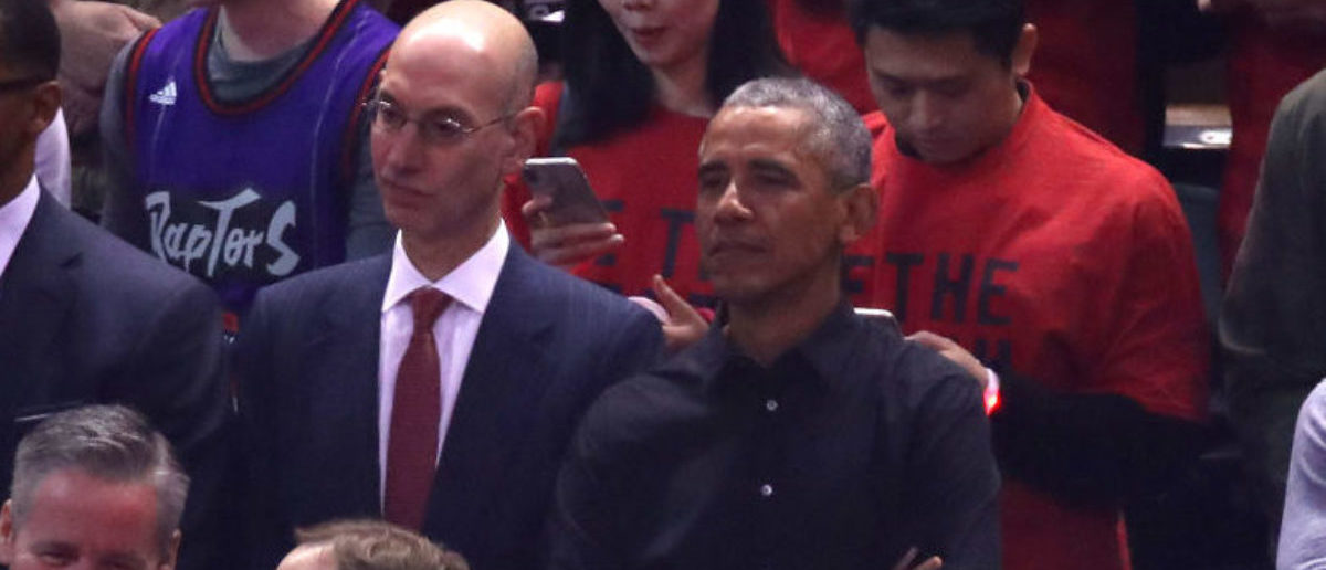TORONTO, ONTARIO - JUNE 02: NBA Commissioner Adam Silver and former President of the United States, Barack Obama look on prior to Game Two of the 2019 NBA Finals between the Golden State Warriors and the Toronto Raptors at Scotiabank Arena on June 02, 2019 in Toronto, Canada. (Photo by Gregory Shamus/Getty Images)