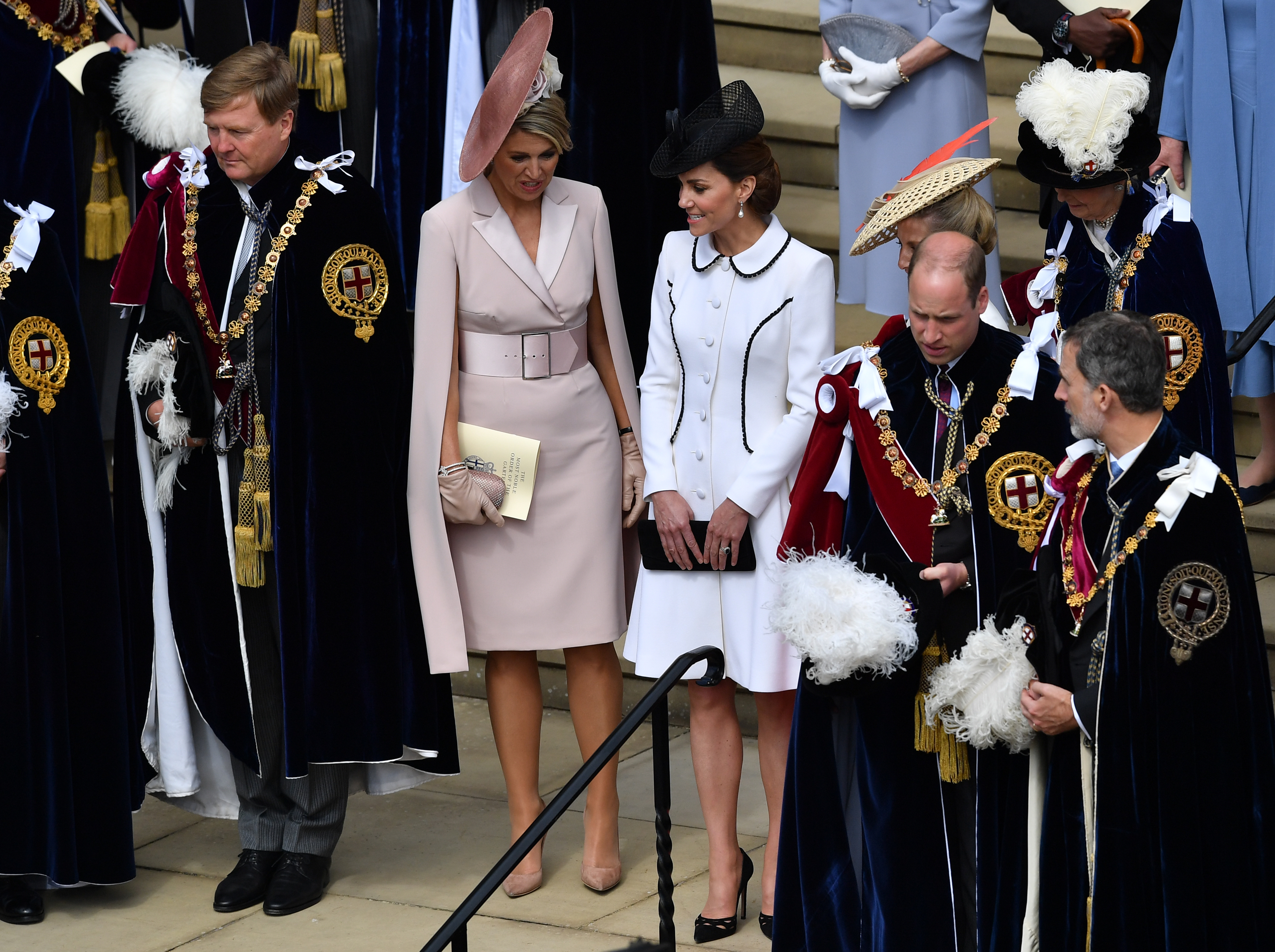King Willem-Alexander of the Netherlands (L), Queen Maxima of the Netherlands (2L), Catherine, Duchess of Cambridge (C) Prince William, Duke of Cambridge (3R) and King Felipe of Spain (R) wait as Queen Elizabeth II leaves the Order of the Garter Service on June 17, 2019 in Windsor, England. The Order of the Garter is the senior and oldest British Order of Chivalry, founded by Edward III in 1348. The Garter ceremonial dates from 1948, when formal installation was revived by King George VI for the first time since 1805. (Photo by Ben Stansall - WPA Pool/Getty Images)