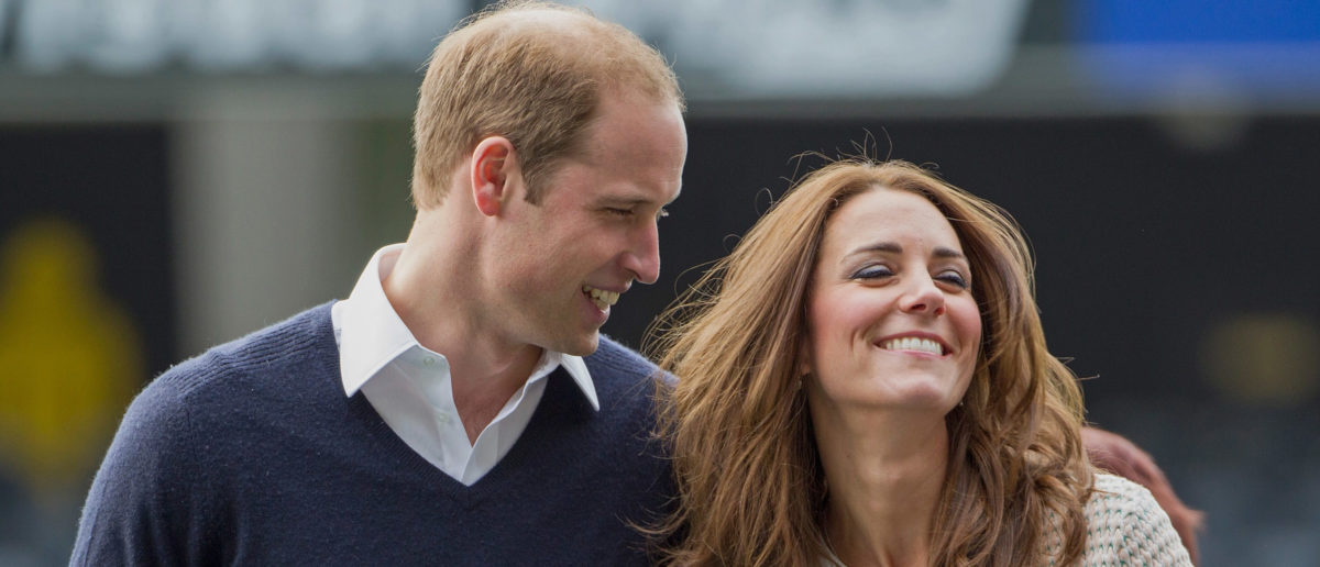 (L-R) Prince William, Duke of Cambridge and Catherine, Duchess of Cambridge attend 'Rippa Rugby' in the Forstyth Barr Stadium on day 7 of a Royal Tour to New Zealand on April 13, 2014 in Dunedin, New Zealand. The Duke and Duchess of Cambridge are on a three-week tour of Australia and New Zealand, the first official trip overseas with their son, Prince George of Cambridge. (Photo by David Rowland - Pool/Getty Images)