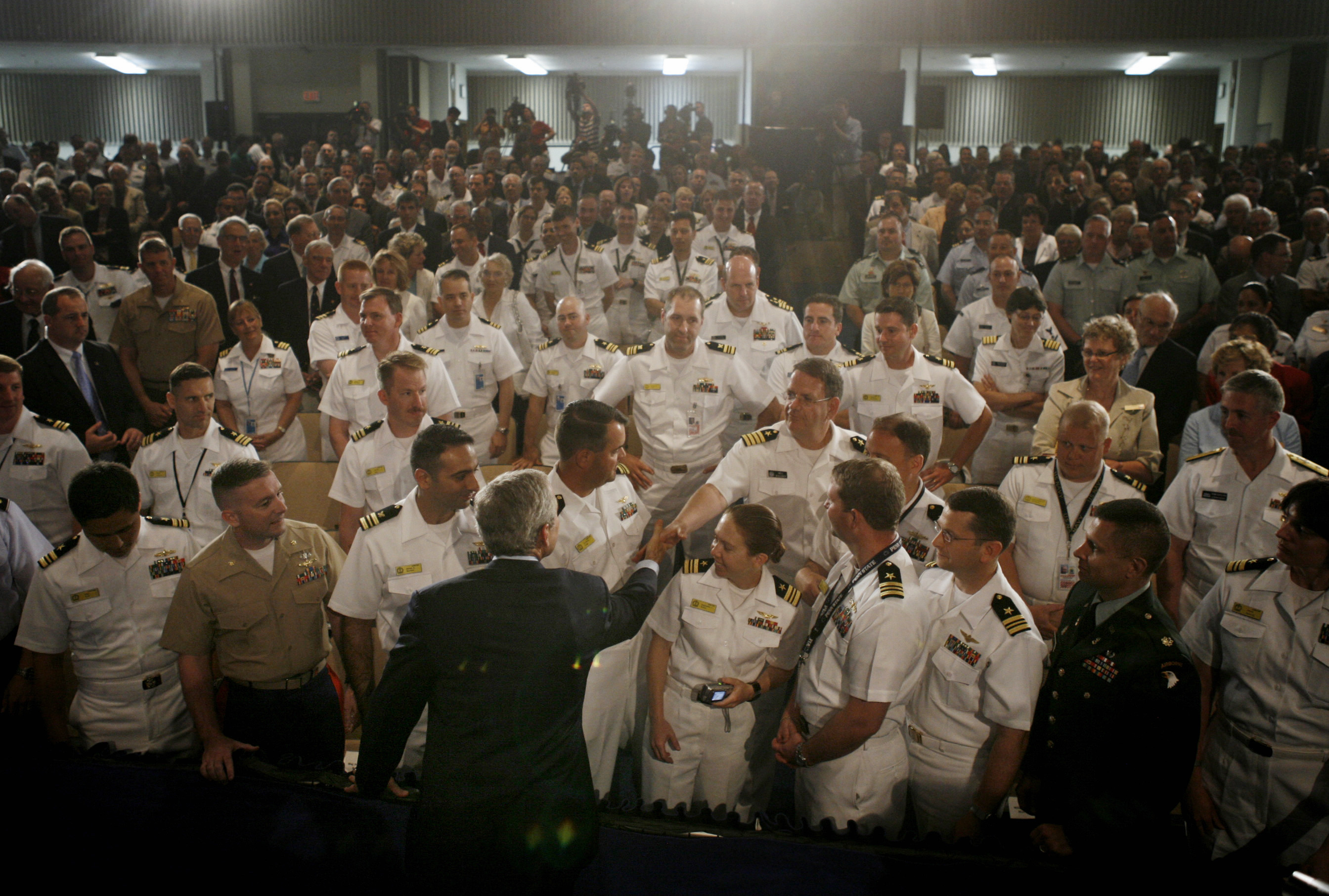 U.S. President George W. Bush greets naval and marine officers following remarks on the war in Iraq at the Naval War College (Jason Reed/Reuters)