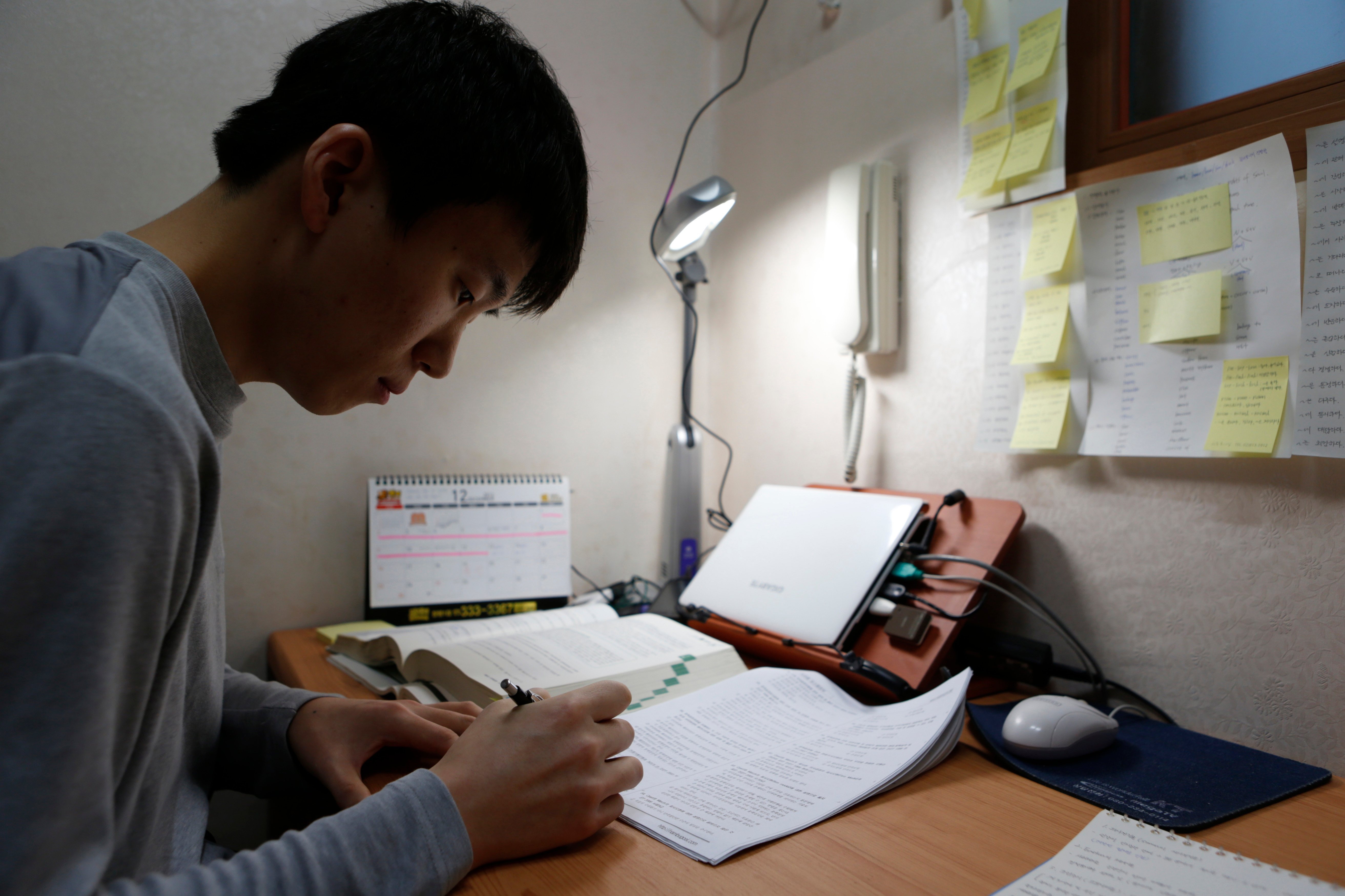 Kim Sa-myeong, 27, studies in his small room called a 'Goshiwon' in one of the many private dorms that house students cramming for exams in Seoul December 13, 2012. There are 30,000 residents of a drab neighbourhood of the South Korean capital known as Exam Village, where people preparing for tests for low-level civil service jobs have gravitated for years. There is a growing sense of frustration among the young in a country where there are simply not enough jobs to go round, especially for graduates of less prestigious universities whose options are largely limited to the public sector. In Exam Village, or Goshichon in Korean, there were so many young people who wanted to cast early ballots last week that extra polling booths had to be brought in. Picture taken December 13, 2012. To match Analysis REUTERS/Lee Jae-Won