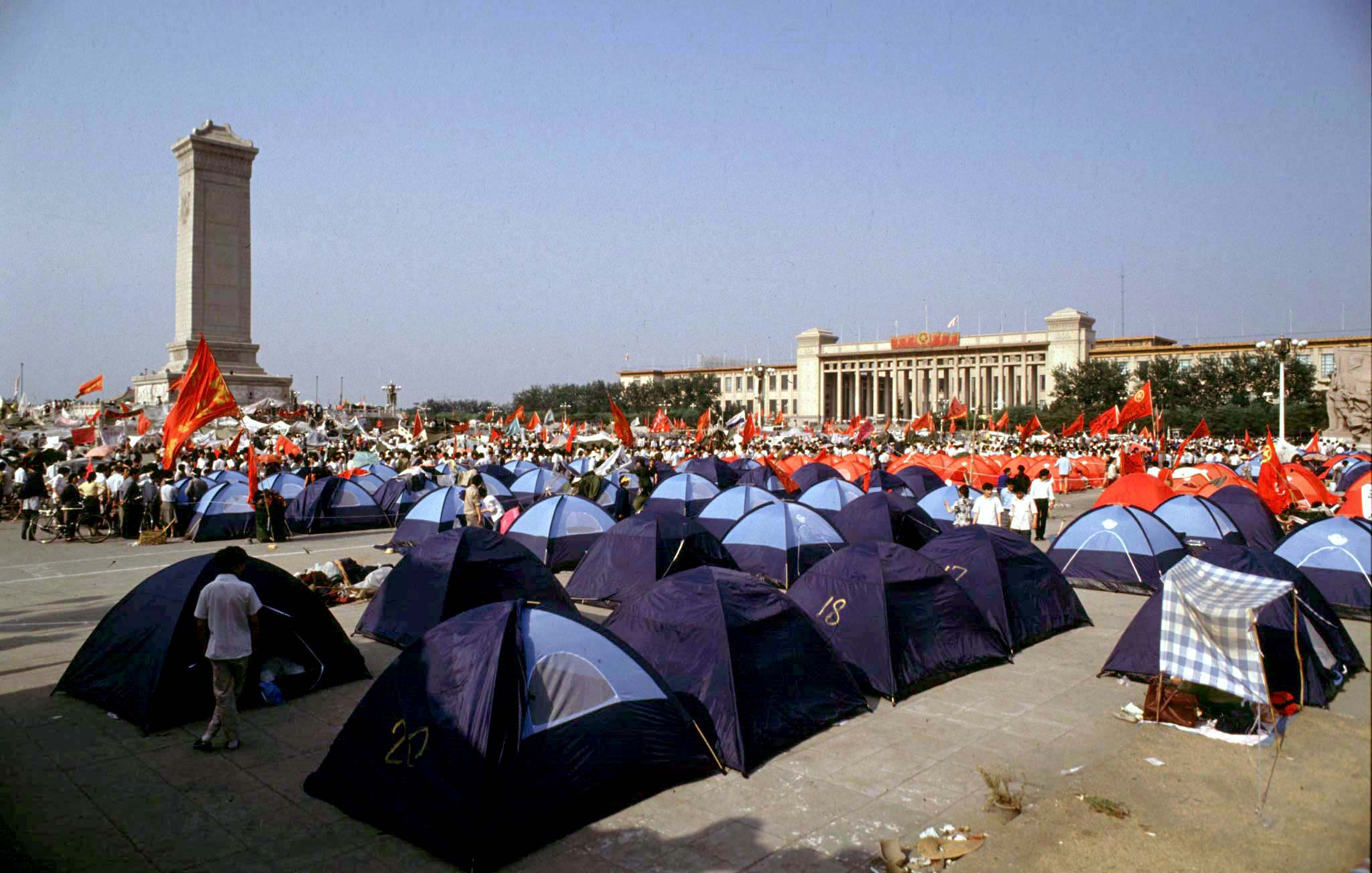 Pro-democracy demonstrators pitch tents in Beijing's Tiananmen Square before their protests were crushed by the People's Liberation Army on June 3, 1989. REUTERS/Bobby Yip