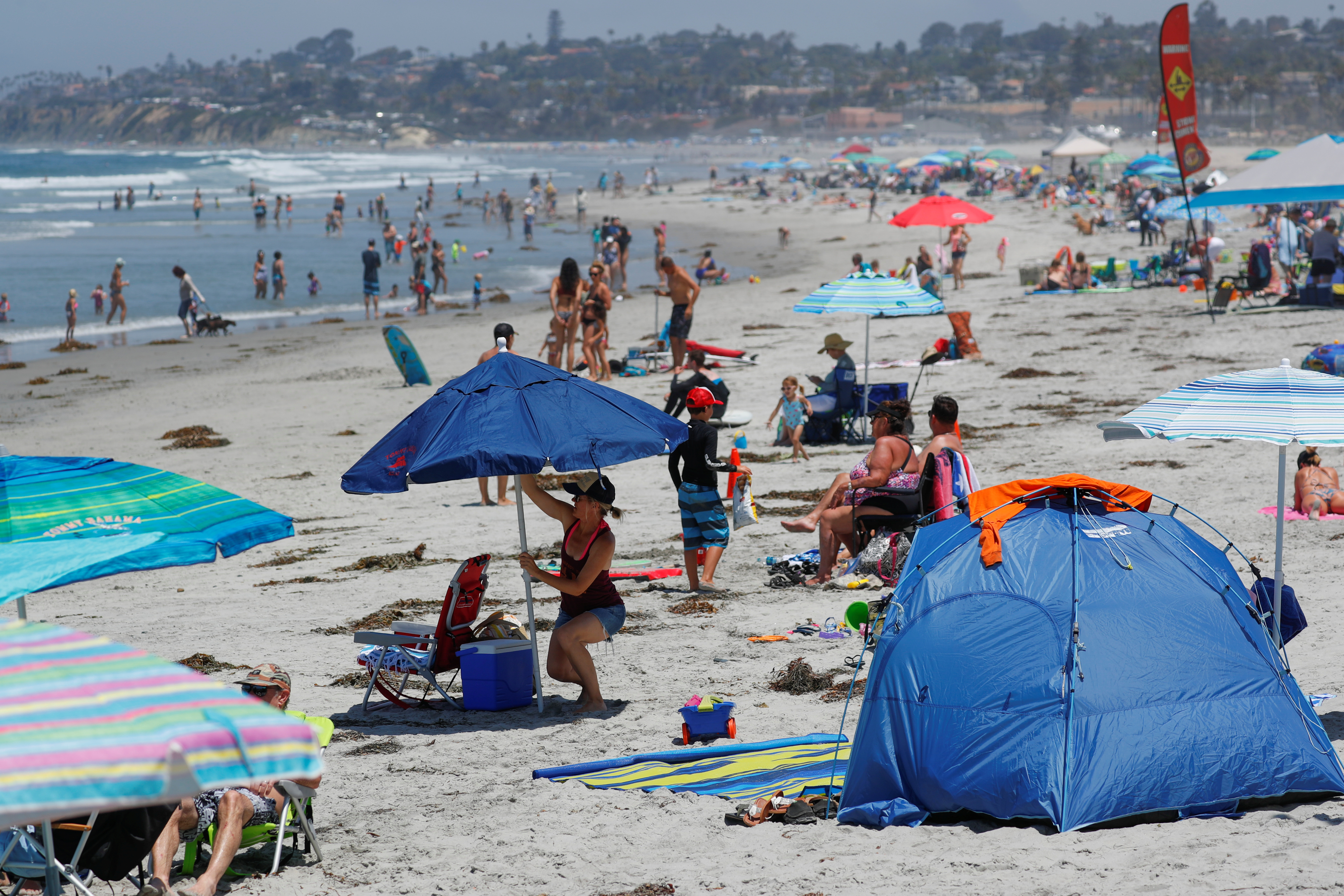 People cool off from a Southern California heat wave at Cardiff State beach in Encinitas, California