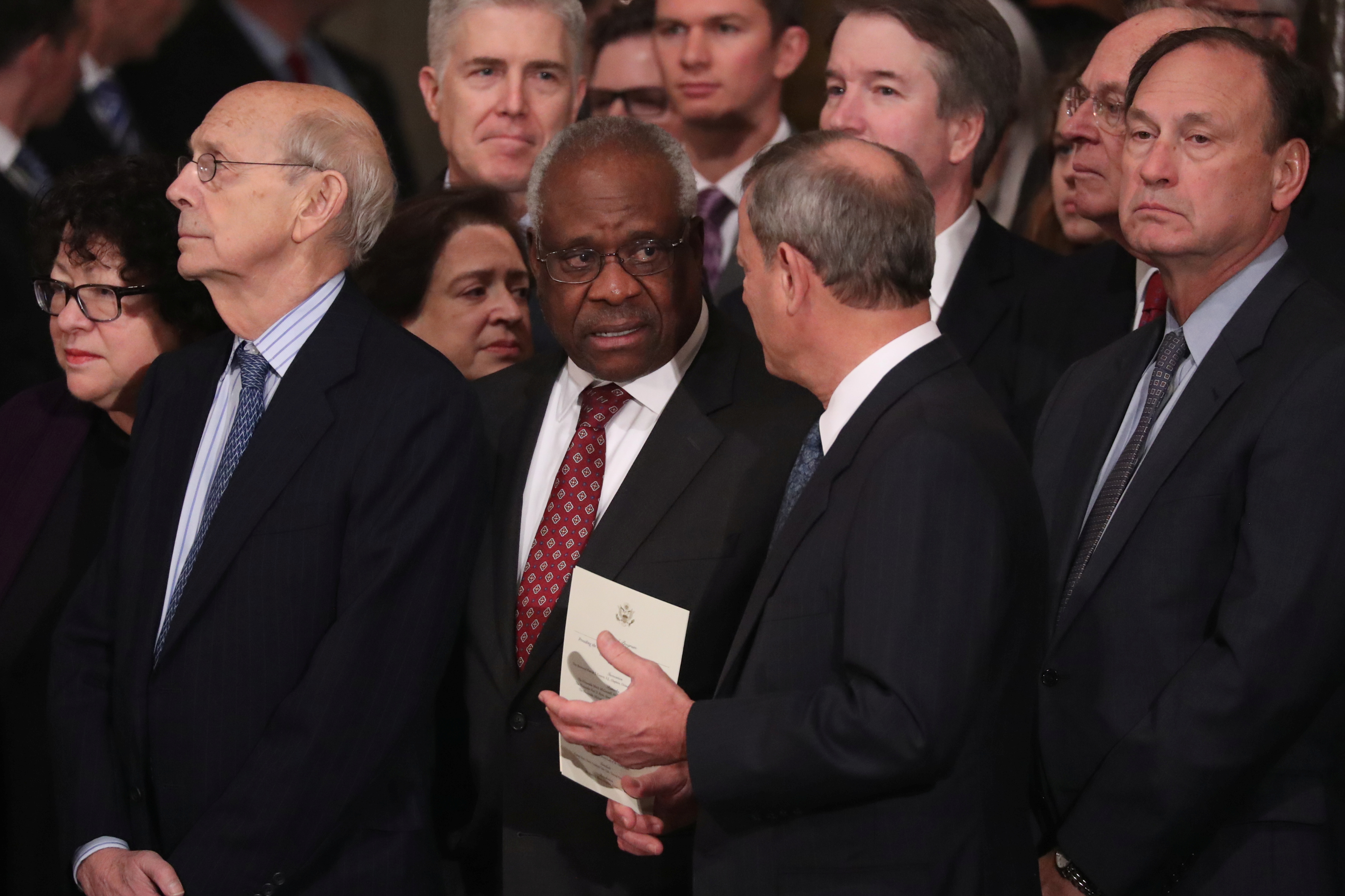 Justices of the U.S. Supreme Court including (L-R) Associate Justices Sonia Sotomayor, Stephen Breyer, Elena Kagan, Neil Gorsuch, Clarence Thomas, Chief Justice John Roberts, Associate Justice Brett Kavanaugh, former Associate Justice Anthony Kennedy and Associate Justice Samuel Alito await the arrival of the casket of former U.S. President George H.W. Bush inside the U.S. Capitol Rotunda, where it will lie in state in Washington, U.S., December 3, 2018. REUTERS/Jonathan Ernst/Pool