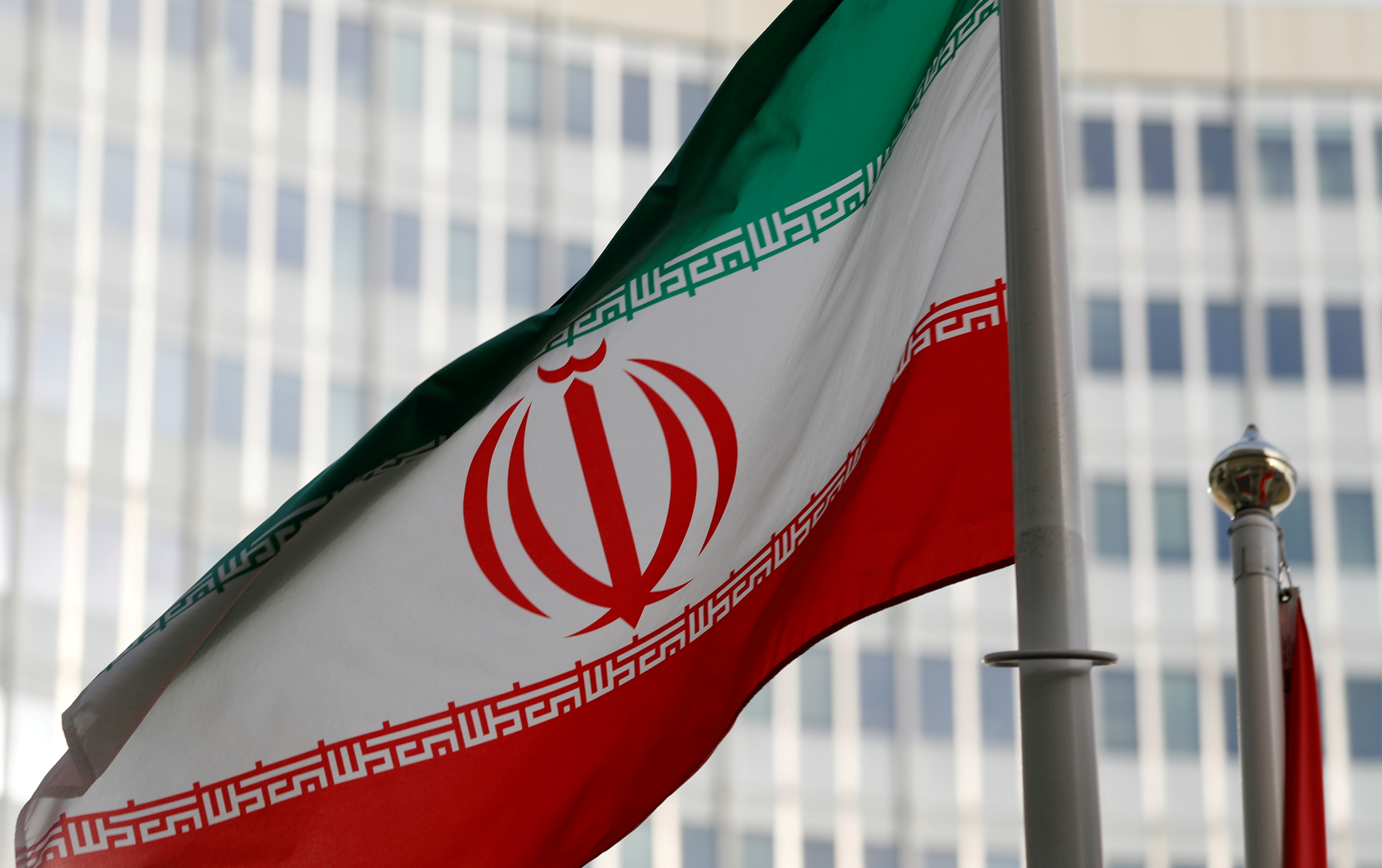 The Iranian flag flutters in front the International Atomic Energy Agency (IAEA) headquarters in Vienna, Austria March 4, 2019. REUTERS/Leonhard Foeger/File Photo