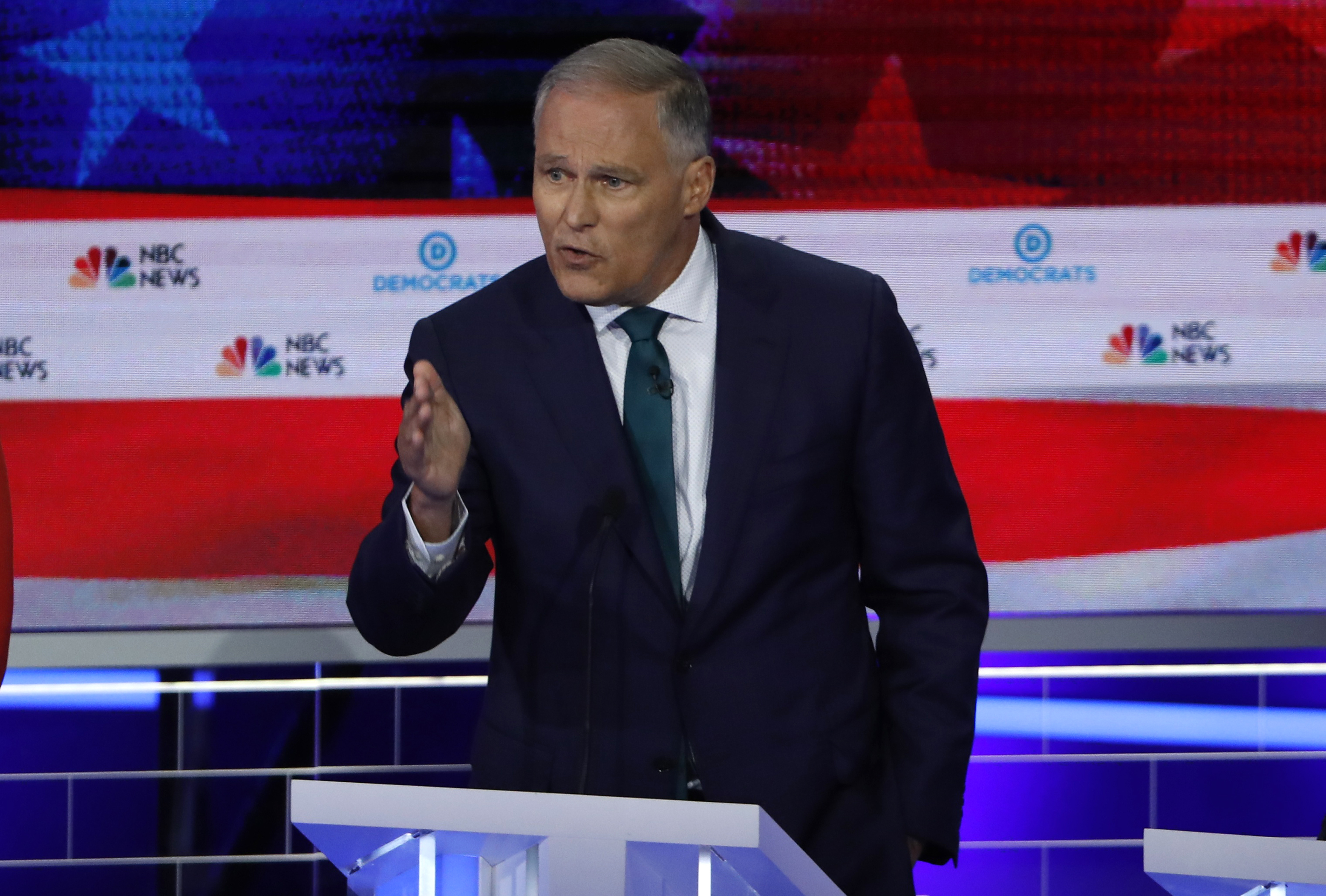Washington Governor Jay Inslee speaks at the first U.S. 2020 presidential election Democratic candidates debate in Miami, Florida, U.S.,