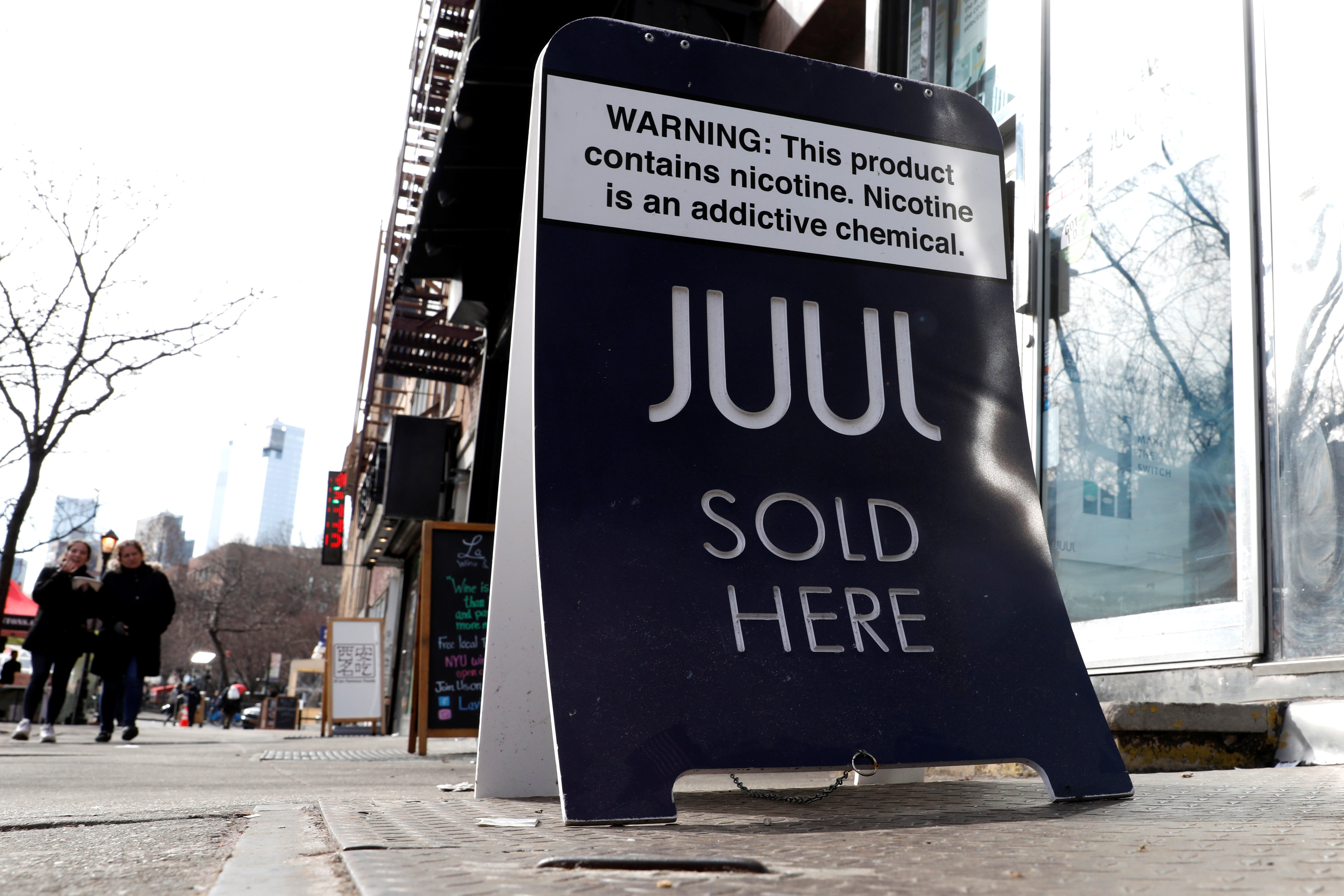A sign advertising Juul brand vaping products is seen outside a shop in Manhattan in New York City, New York, U.S., February 6, 2019. REUTERS/Mike Segar
