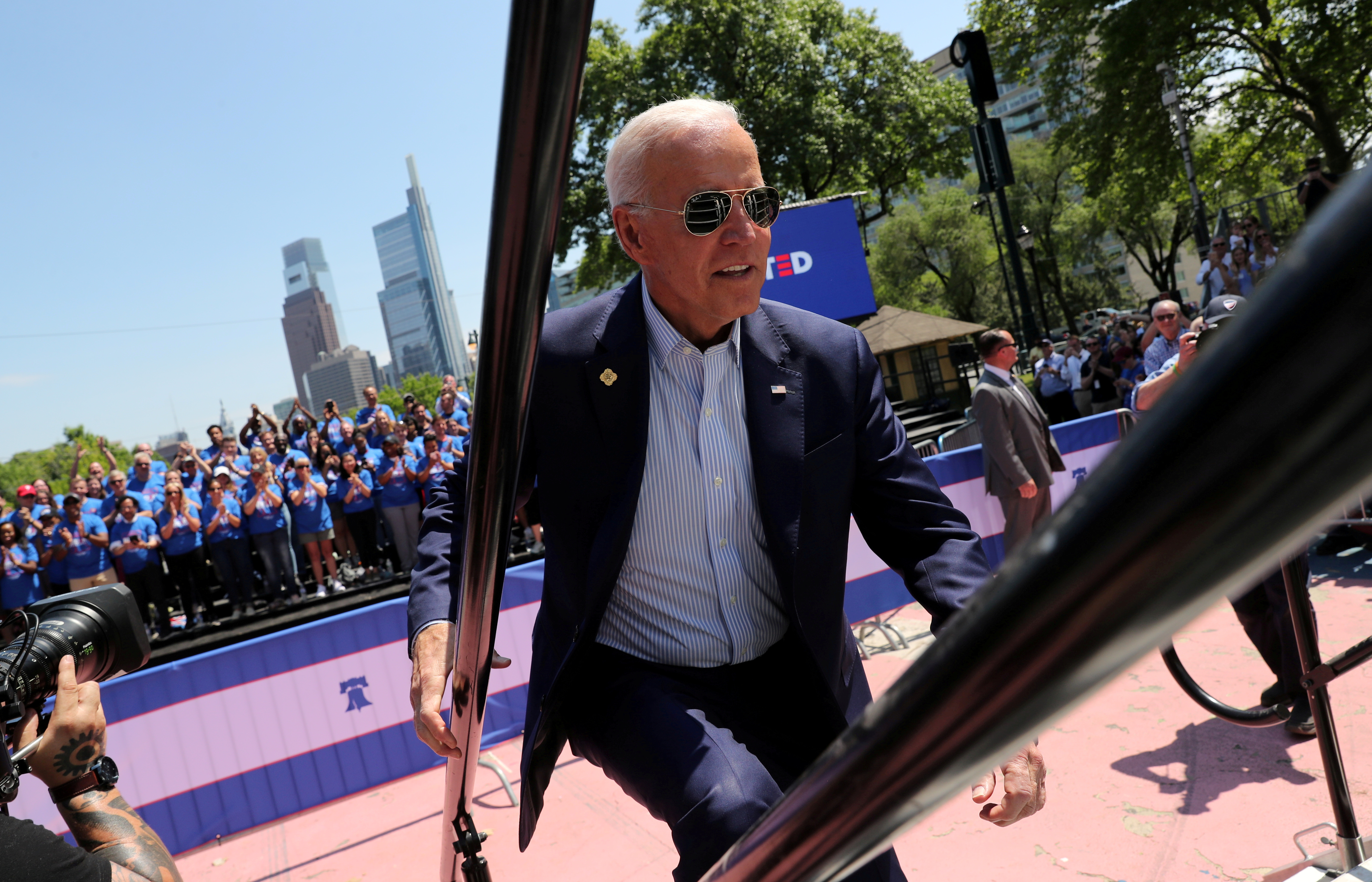 U.S. Democratic presidential candidate and former Vice President Joe Biden runs up the steps onto the stage to begin the kickoff rally of his campaign