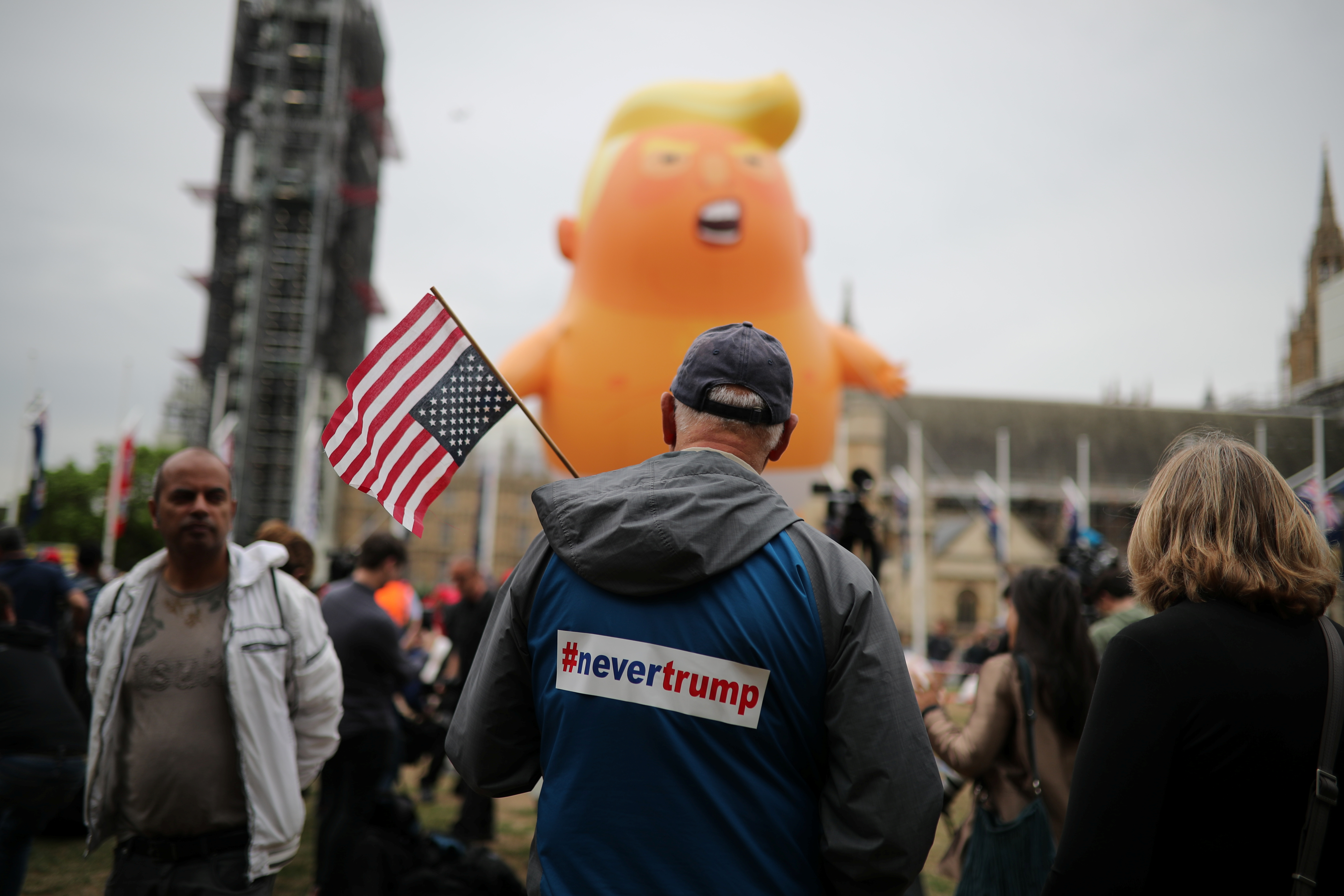"A ""Baby Trump"" balloon is seen over demonstrators as they participate in an anti-Trump protest in London, Britain, June 4, 2019. REUTERS/Alkis Konstantinidis"