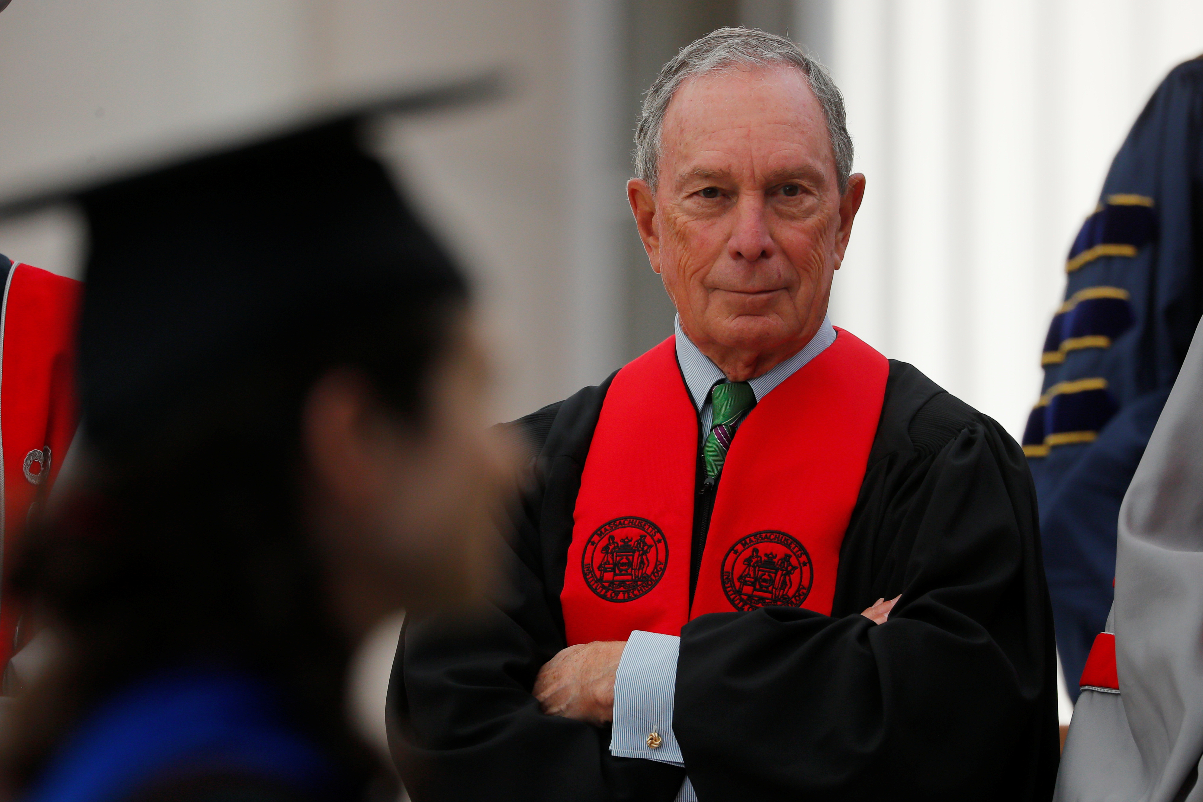 Commencement speaker Michael Bloomberg watches as graduating students arrive for Commencement Exercises at MIT in Cambridge