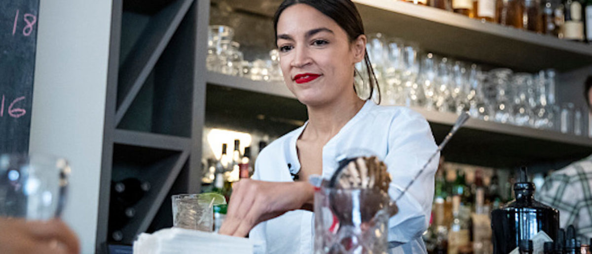 NEW YORK, NY - MAY 31: U.S. Rep. Alexandria Ocasio-Cortez (D-NY) works behind the bar at the Queensboro Restaurant, May 31, 2019 in the Queens borough of New York City. Ocasio-Cortez participated in an event to raise awareness for the One Fair Wage campaign, which calls to raise the minimum wage for tipped workers to a full minimum wage at the federal level. (Photo by Drew Angerer/Getty Images)
