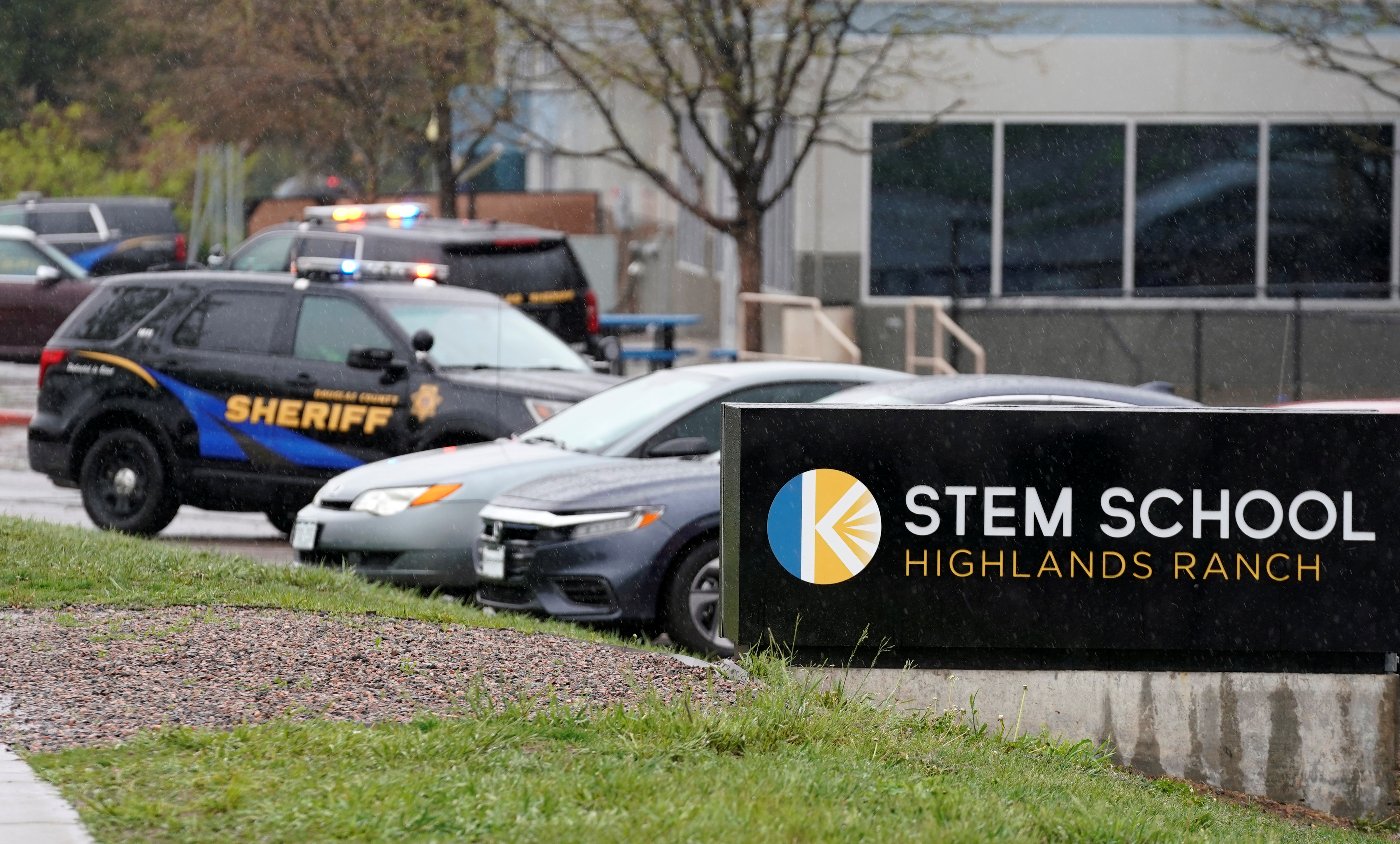 Police vehicles are stationed outside the school following the shooting at the Science, Technology, Engineering and Math (STEM) School in Highlands Ranch, Colorado, U.S., May 8, 2019. REUTERS/Rick Wilking