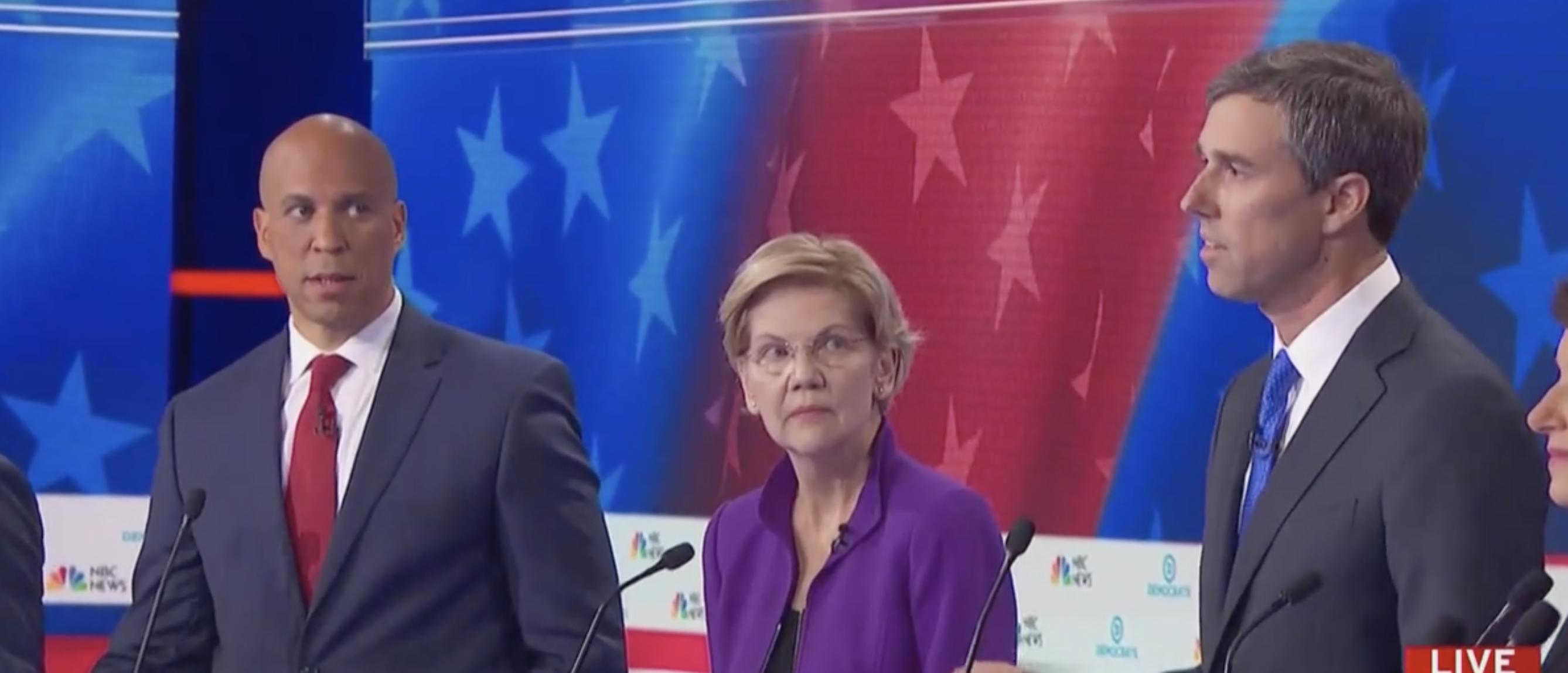 Cory Booker looked shocked as Beto O'Rouke answered his first question of the evening in Spanish. (Screenshot Youtube/MSNBC)