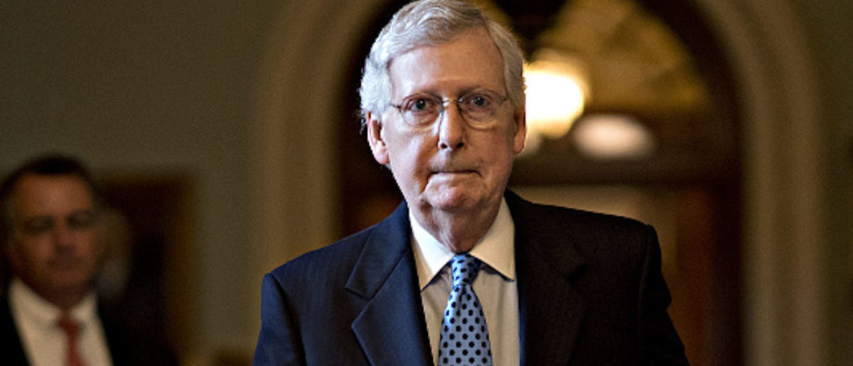 """Senate Majority Leader Mitch McConnell, a Republican from Kentucky, walks to his office after a weekly conference meeting at the U.S. Capitol in Washington, D.C., U.S., on Tuesday, June 18, 2019. McConnell today praised the Trump administration's plan to send 1,000 additional troops to the Middle East and placed blame for the risk of conflict on """"Tehran's decisions to resort to violence."""" Photographer: Andrew Harrer/Bloomberg via Getty Images"""