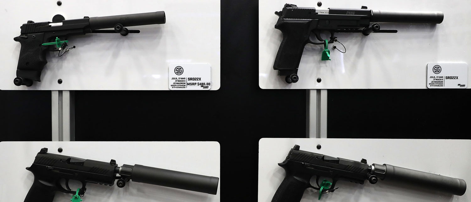 Sig Sauer hanguns with silencers are displayed during the National Rifle Association's annual meeting on May 5, 2018 in Dallas, Texas. (Justin Sullivan/Getty Images)