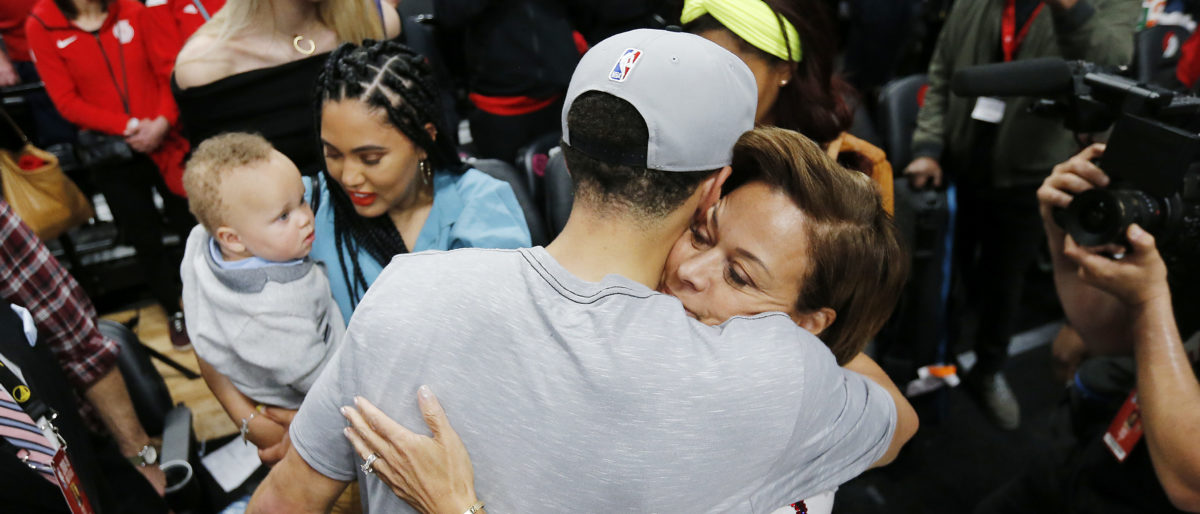 Stephen Curry #30 of the Golden State Warriors celebrates with mom Sonya Curry after defeating the Portland Trail Blazers 119-117 during overtime in game four of the NBA Western Conference Finals to advance to the 2019 NBA Finals at Moda Center on May 20, 2019 in Portland, Oregon. NOTE TO USER: User expressly acknowledges and agrees that, by downloading and or using this photograph, User is consenting to the terms and conditions of the Getty Images License Agreement. (Photo by Jonathan Ferrey/Getty Images)