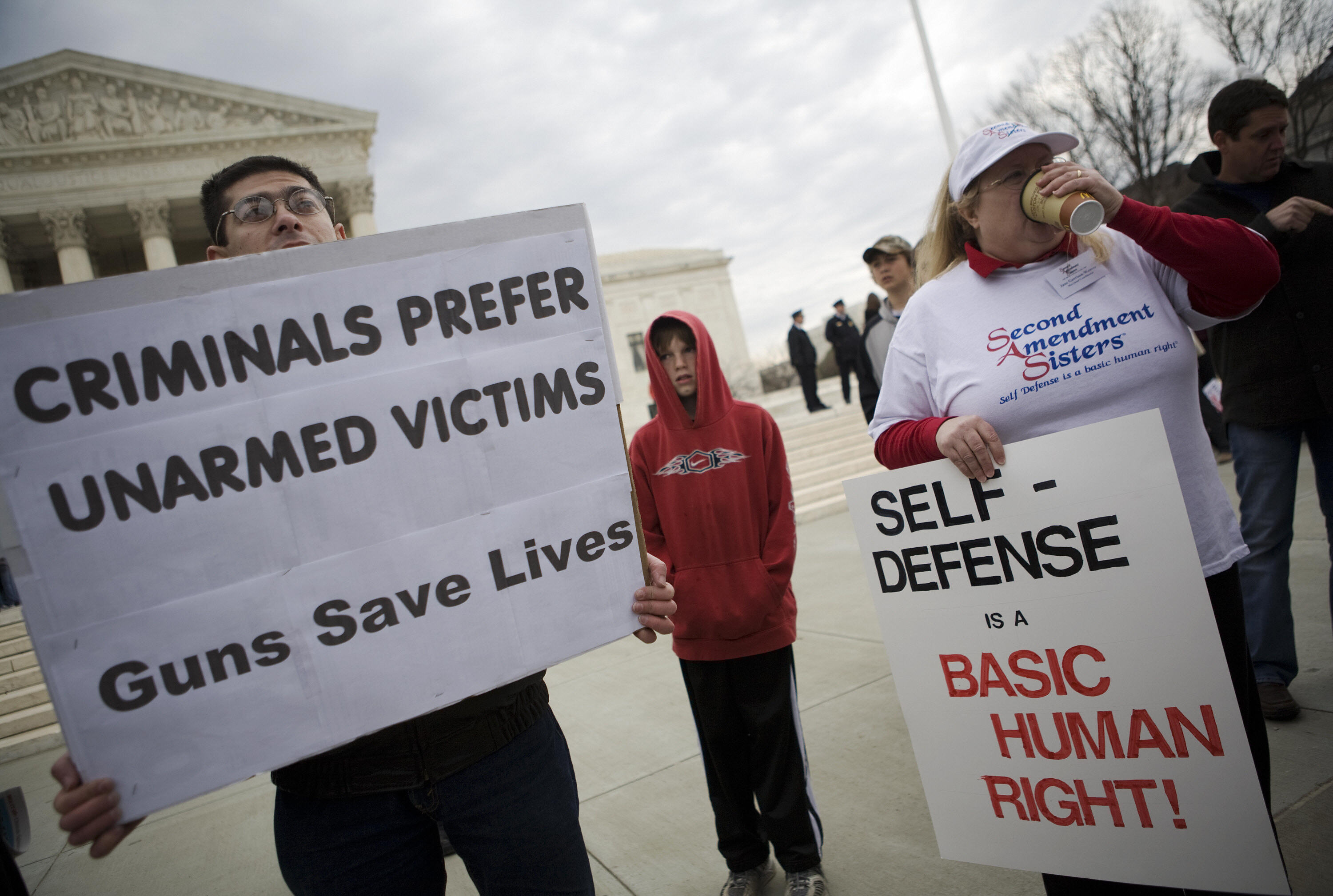 Gun rights supporters hold placards outside of the Supreme Court on March 18, 2008. (Mandel Ngan/AFP/Getty Images)