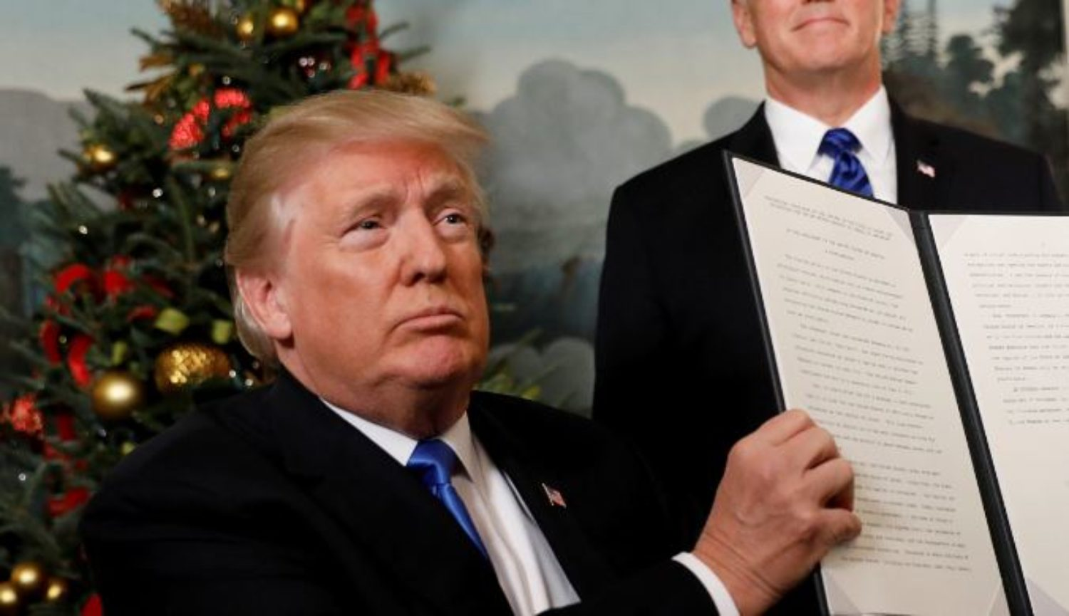 U.S. President Donald Trump holds up the signed proclamation that the United States recognizes Jerusalem as the capital of Israel and will move its embassy there, during an address from the White House in Washington, DC, U.S. December 6, 2017. REUTERS/Kevin Lamarque/