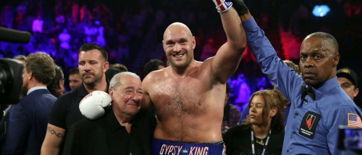 LAS VEGAS, NEVADA - JUNE 15: Tyson Fury (C) poses with boxing promoter Bob Arum (L) and referee Kenny Bayless after defeating Tom Schwarz during a heavyweight fight at MGM Grand Garden Arena on June 15, 2019 in Las Vegas, Nevada. Fury won with a second-round TKO. (Photo by Steve Marcus/Getty Images)