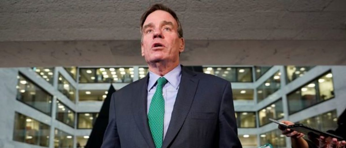 U.S. Senator and Senate Intelligence Committee ranking member Mark Warner (D-VA) speaks to reporters inside the Hart Senate Office Building where former Trump personal attorney Michael Cohen testified behind closed doors before the committee on Capitol Hill in Washington, U.S., February 26, 2019. REUTERS/Kevin Lamarque