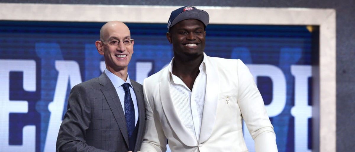 NEW YORK, NEW YORK - JUNE 20: Zion Williamson poses with NBA Commissioner Adam Silver after being drafted with the first overall pick by the New Orleans Pelicans during the 2019 NBA Draft at the Barclays Center on June 20, 2019 in the Brooklyn borough of New York City. (Photo by Sarah Stier/Getty Images)