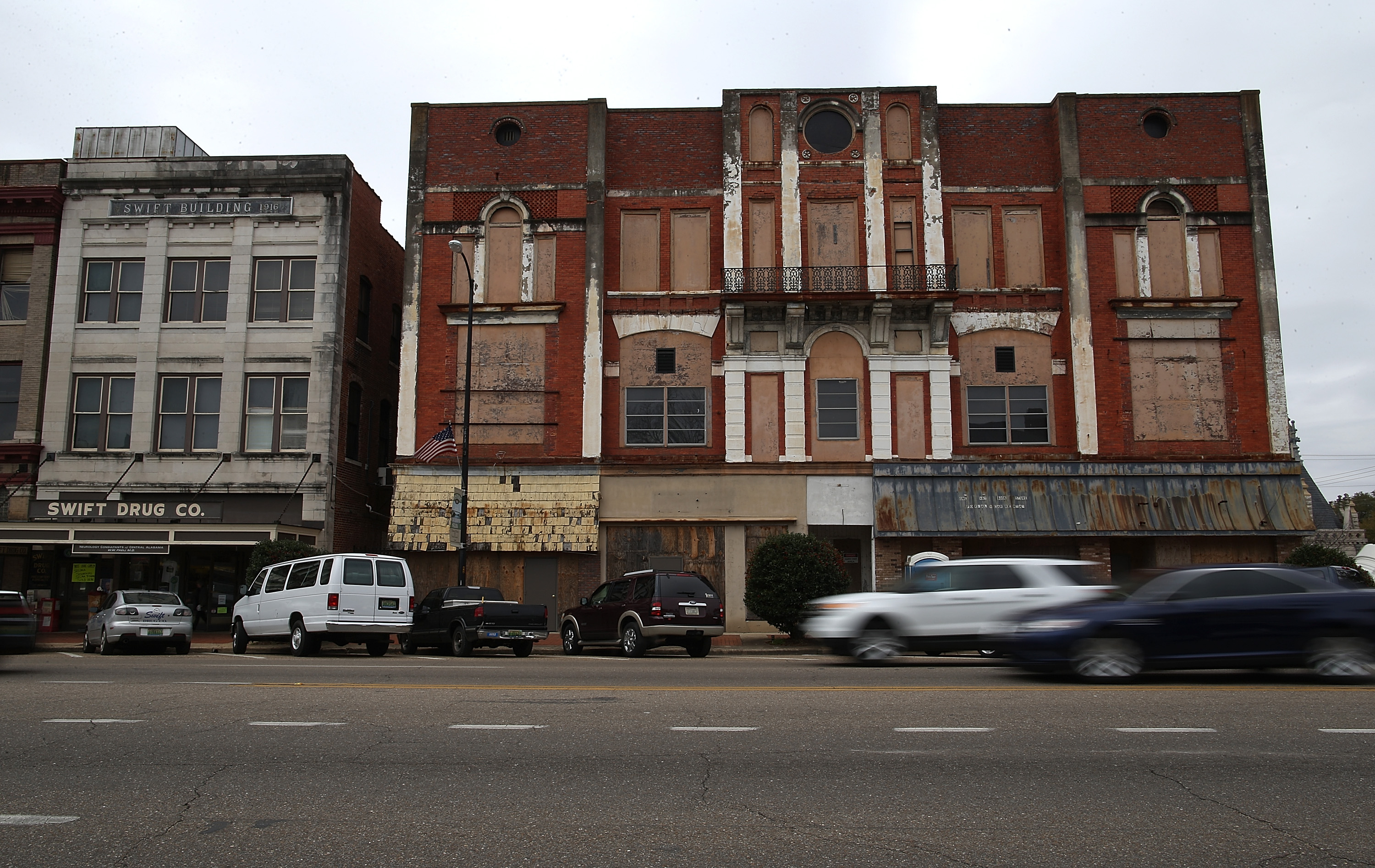Cars drive by a boarded up building in Selma, Alabama. 50 years after the historic civil rights march from Selma to Montgomery where marchers were beaten by State police officers as they crossed the Edmund Pettus Bridge, Selma struggles economically and is one of the poorest cities in Alabama (Justin Sullivan/Getty Images)