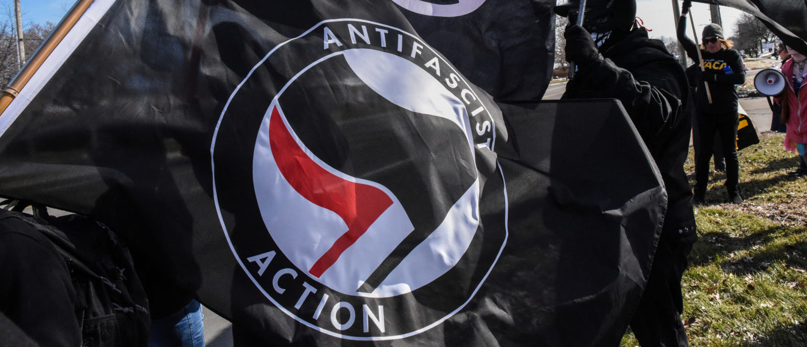 Members of the Great Lakes anti-fascist organization (Antifa) fly flags during a protest against the Alt-right outside a hotel in Warren, Michigan, U.S., March 4, 2018. REUTERS/Stephanie Keith