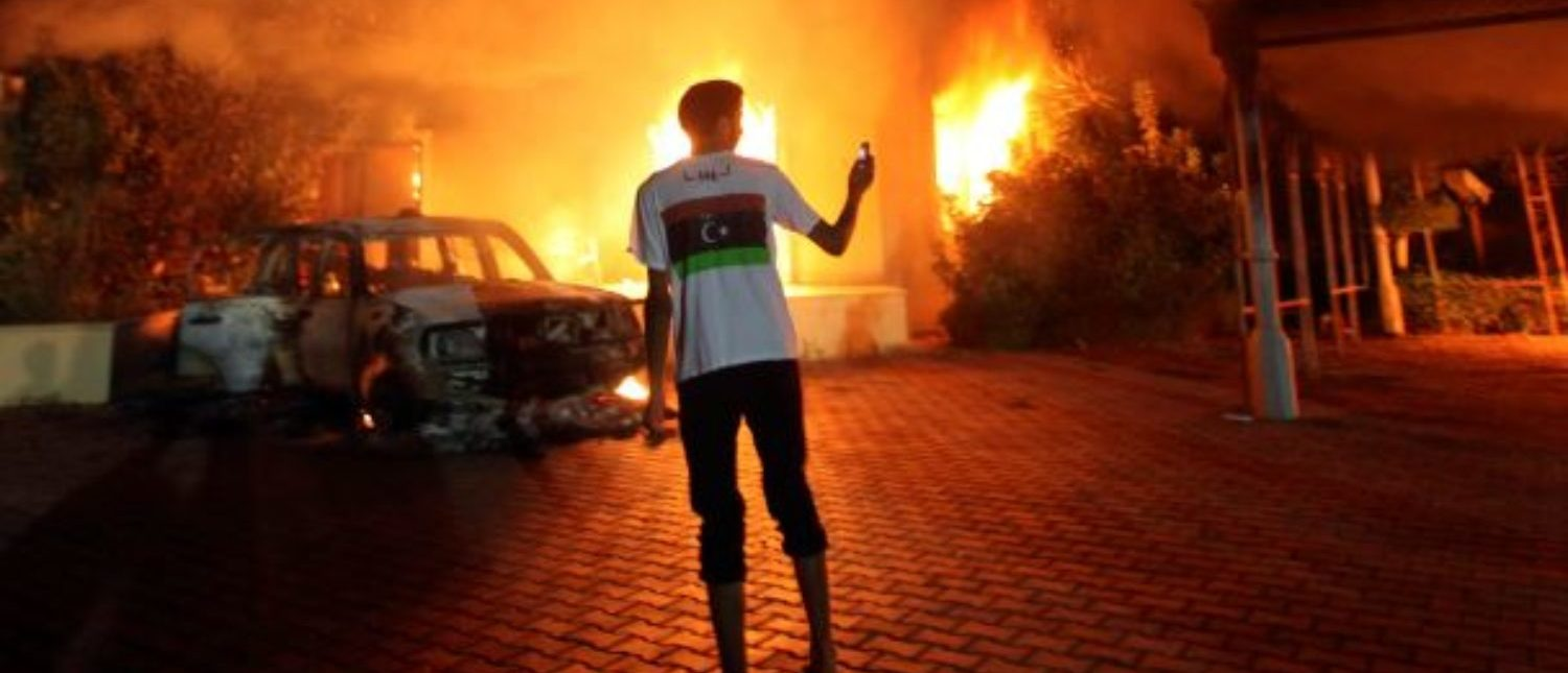 The U.S. Consulate in Benghazi is seen in flames during a protest by an armed group said to have been protesting a film being produced in the United States September 11, 2012. An American staff member of the U.S. consulate in the eastern Libyan city of Benghazi has died following fierce clashes at the compound, Libyan security sources said on Wednesday. Armed gunmen attacked the compound on Tuesday evening, clashing with Libyan security forces before the latter withdrew as they came under heavy fire. REUTERS/Esam Al-Fetori