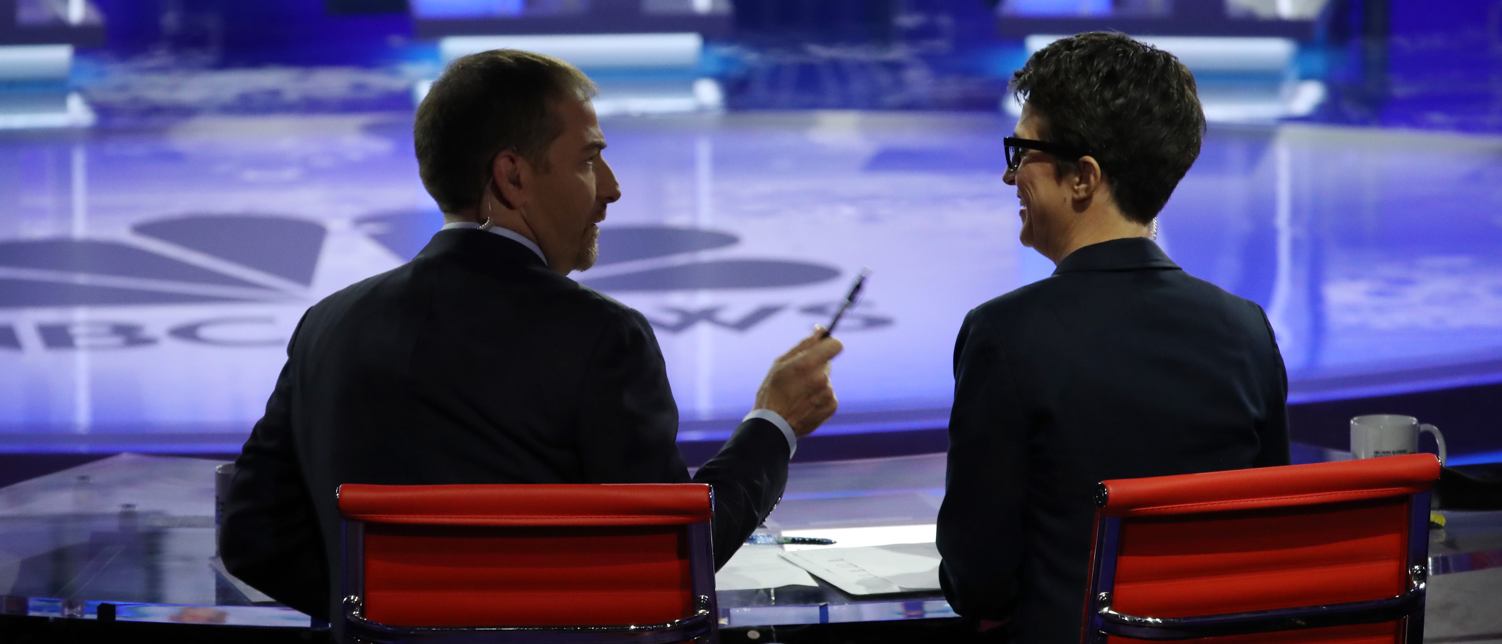 Moderators Chuck Todd of NBC News and Rachel Maddow of MSNBC talk during the second night of the first Democratic presidential debate on June 27, 2019 in Miami, Florida. (Drew Angerer/Getty Images)