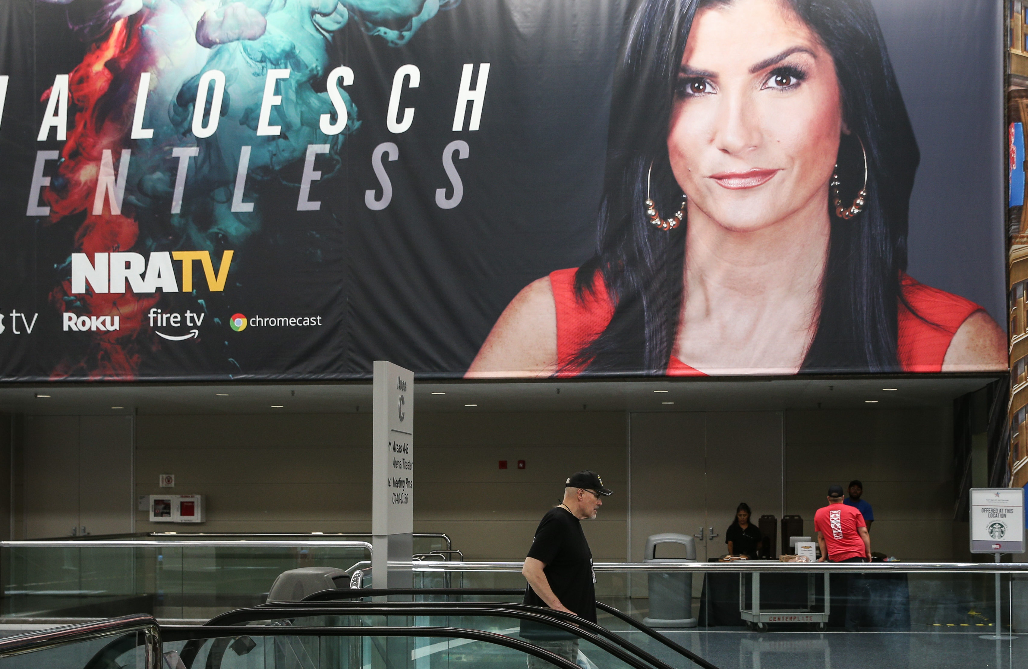 A photo of National Rifle Association spokesperson Dana Loesch decorates a wall at the Kay Bailey Hutchison Convention Center during the NRA's annual convention May 6, 2018 in Dallas, Texas. (Photo by LOREN ELLIOTT/AFP/Getty Images)