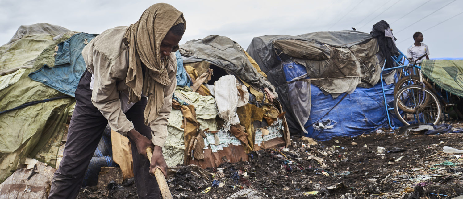 A Fulani man tries to insulate his tent from water after flooding an Internally Displaced People's (IDP) camp in Faladie, where nearly 800 IDPs have found refuge after fleeing inter-communal violence in central Mali, on May 16, 2019. - Built up on a landfill, this camp bears critical hygienic conditions for the displaced people who live surrounded by rubbish. (Photo by MICHELE CATTANI/AFP/Getty Images)