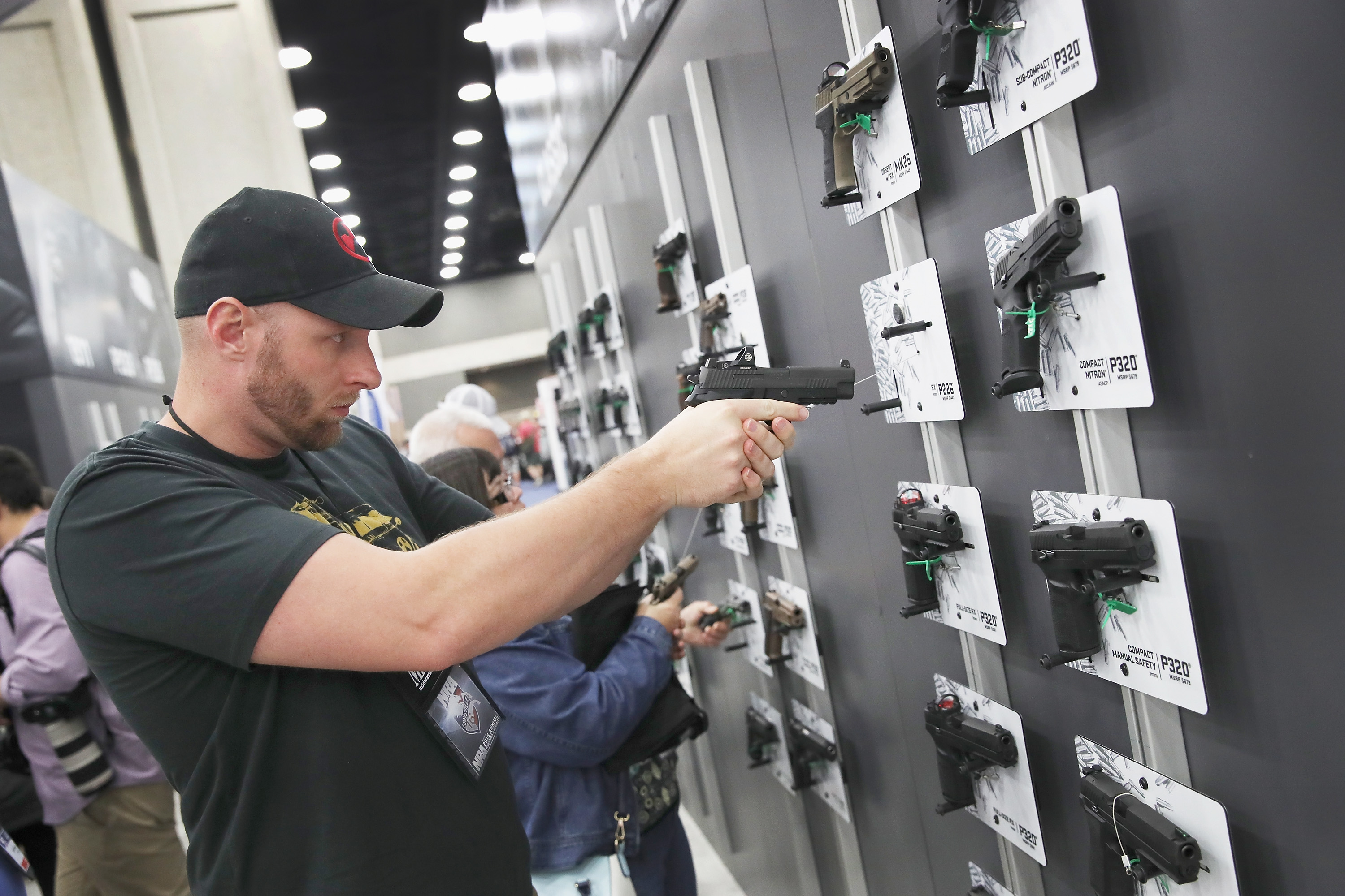 Dale Locher looks over SIG SAUER pistols at the NRA Annual Meetings & Exhibits on May 21, 2016 in Louisville, Kentucky. (Photo by Scott Olson/Getty Images)