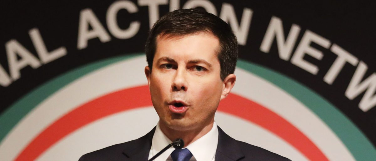 With Rev. Al Sharpton looking on, Democratic presidential hopeful South Bend, Indiana, Mayor Pete Buttigieg speaks at the National Action Network's annual convention on April 4, 2019 in New York City. (Photo by Spencer Platt/Getty Images)